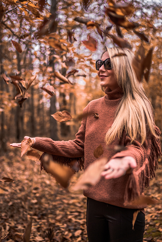 christie ferrari wears fall and winter staple centric look with copper oversized sweater and black faux leather leggings with black boots in Vermont.