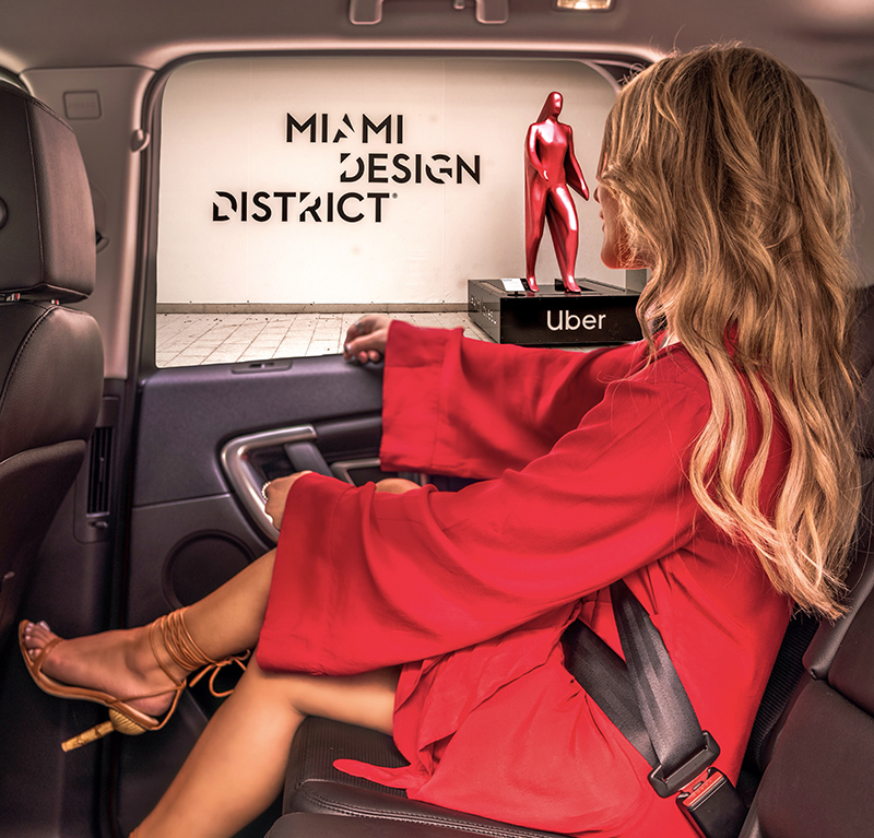 Christie Ferrari attends Art Week in miami 2019 riding uber. wearing red dress from revolve and heels from cult gaia.