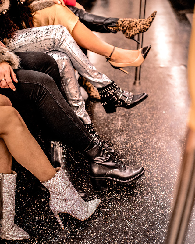 The DSW Style Squad with Christie Ferrari, Tezza, Caila Quinn, Lindsi Lane and Marni wearing shoes to gift the holiday season. black combat boots, leopard booties, beige and black close-toe shoes and nye-ready, glitter booties and shoes.
