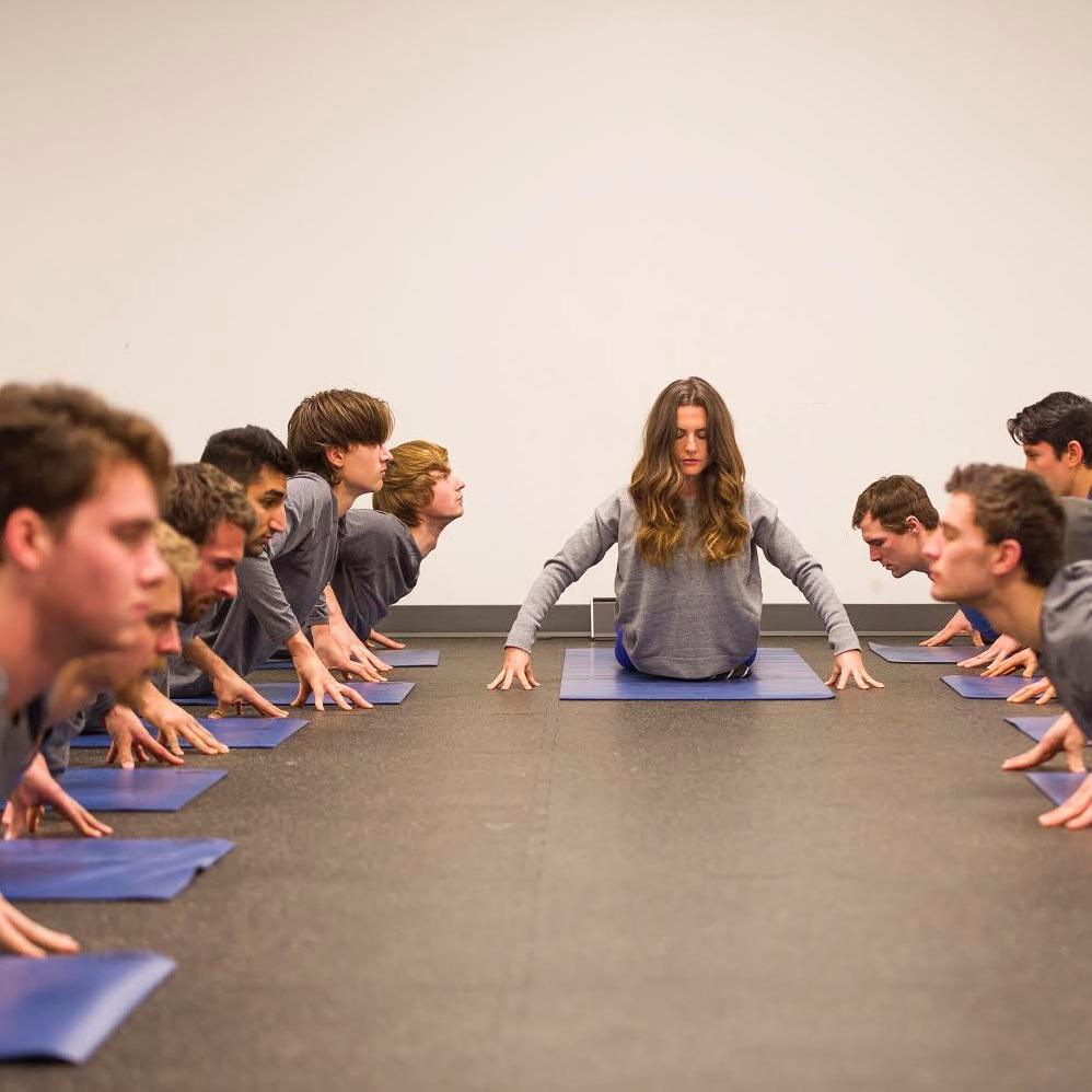 Corporate yoga for UBC Thunderbirds football, hockey and volleyball teams.jpg