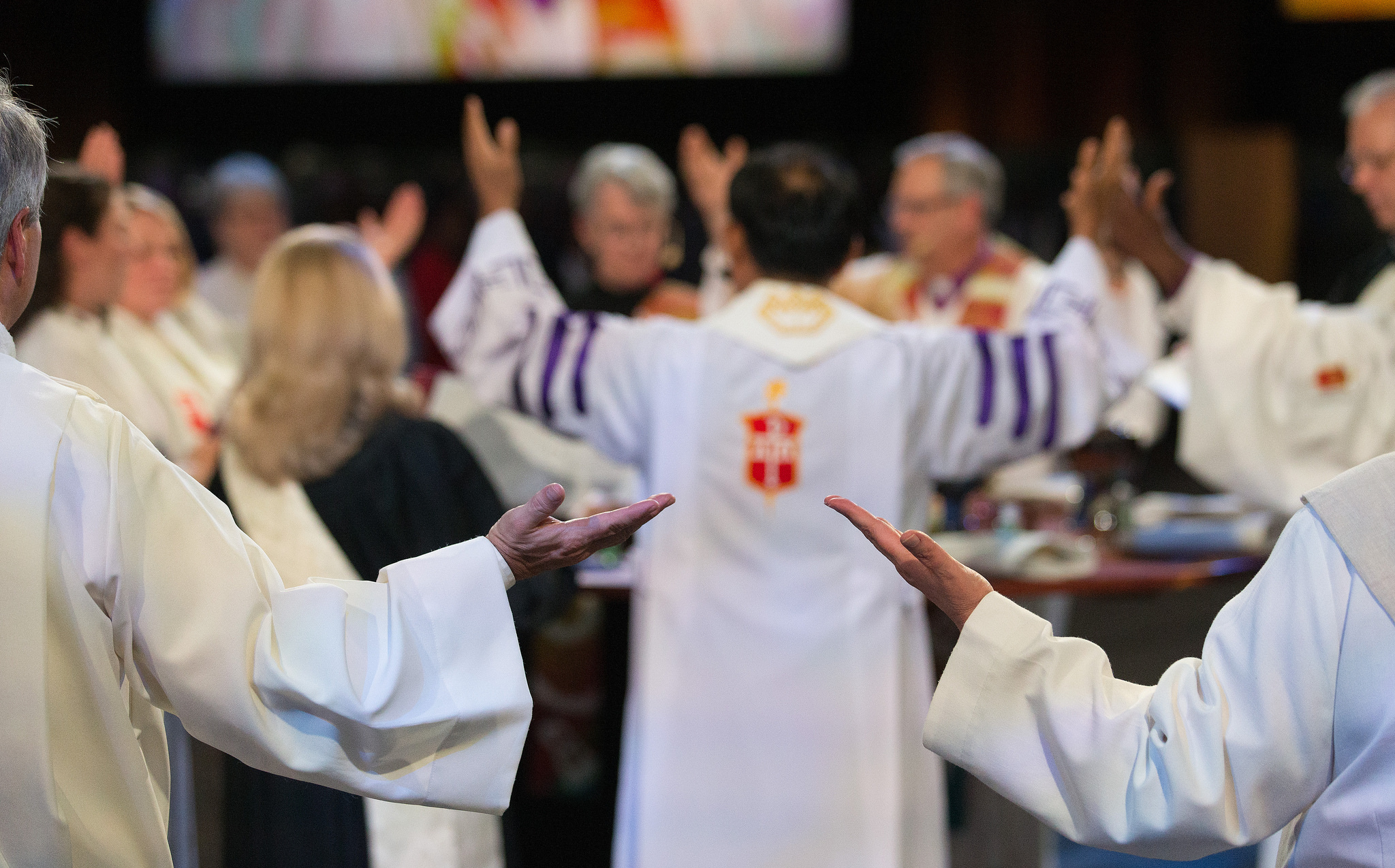 Clergy help to bless the elements for Holy Communion.  Photo credit: Mike DuBose, UMNS