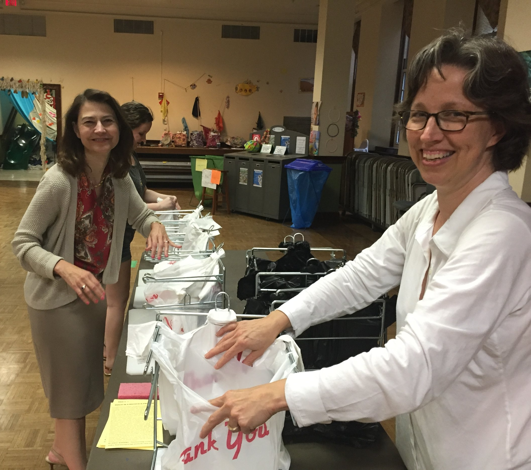 Deborah Marlowe (left) overseeing a Thursday night packing this summer.