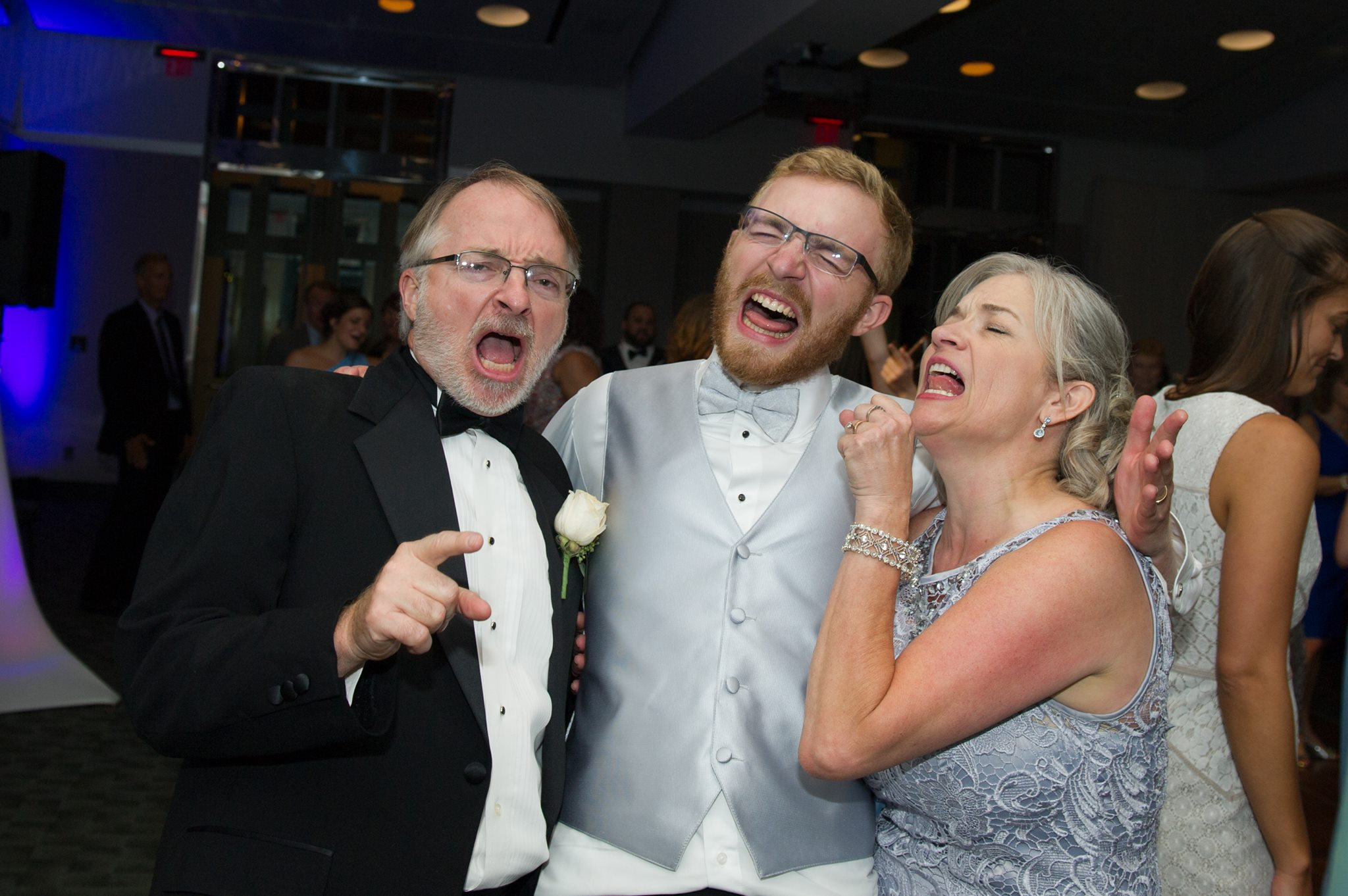 Dancing at his wedding with his parents...to a Journey song?
