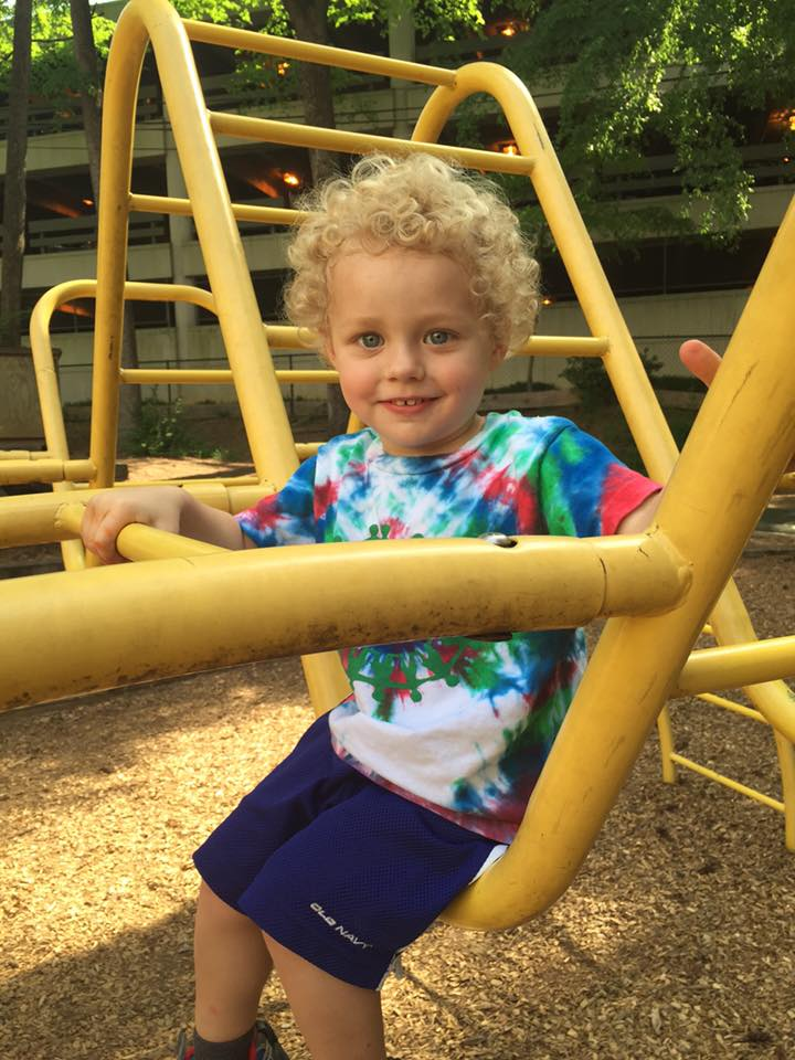 Bethany's son, Adam, feeling brave on the big yellow bug.