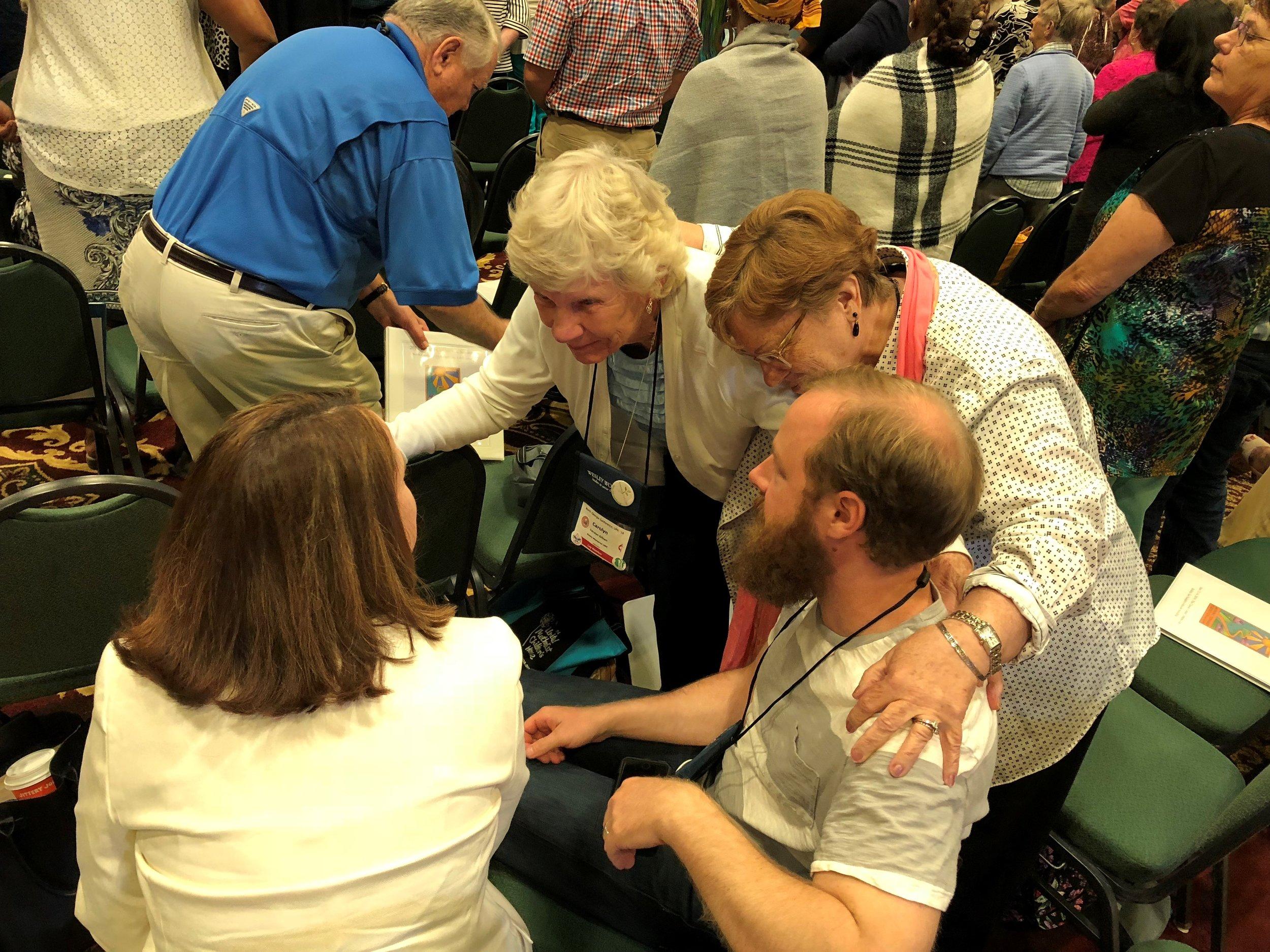 A handful of Glenn's lay delegates hard at work: Katrina Voegtlin, Carolyn Gilbert, Carole Adams, and Andrew Johnson