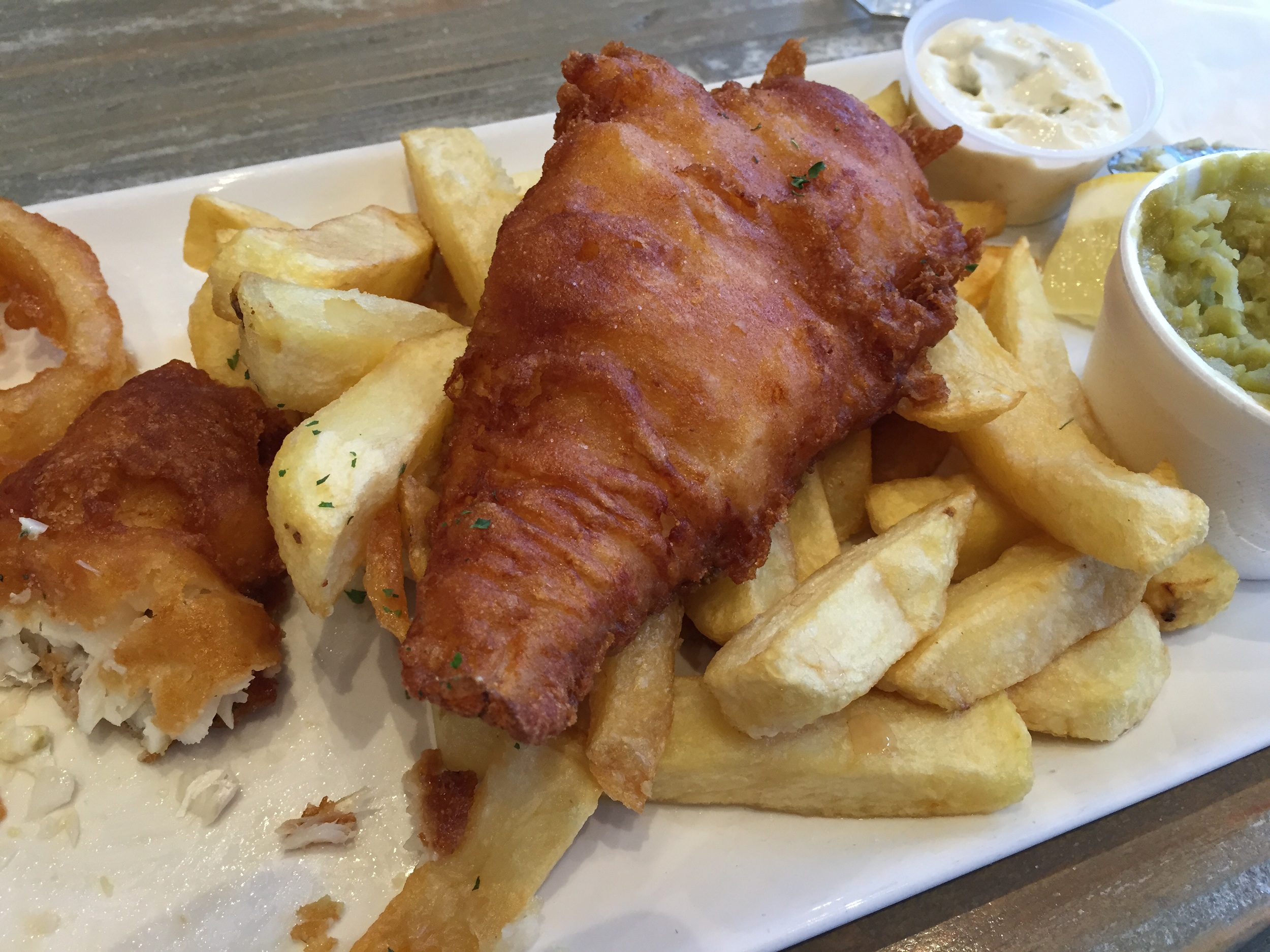 Two HUGE pieces of fish, fresh cut chips, homemade tartar sauce and mushy peas. Both of my fish pieces were the size of two of my hands put together.