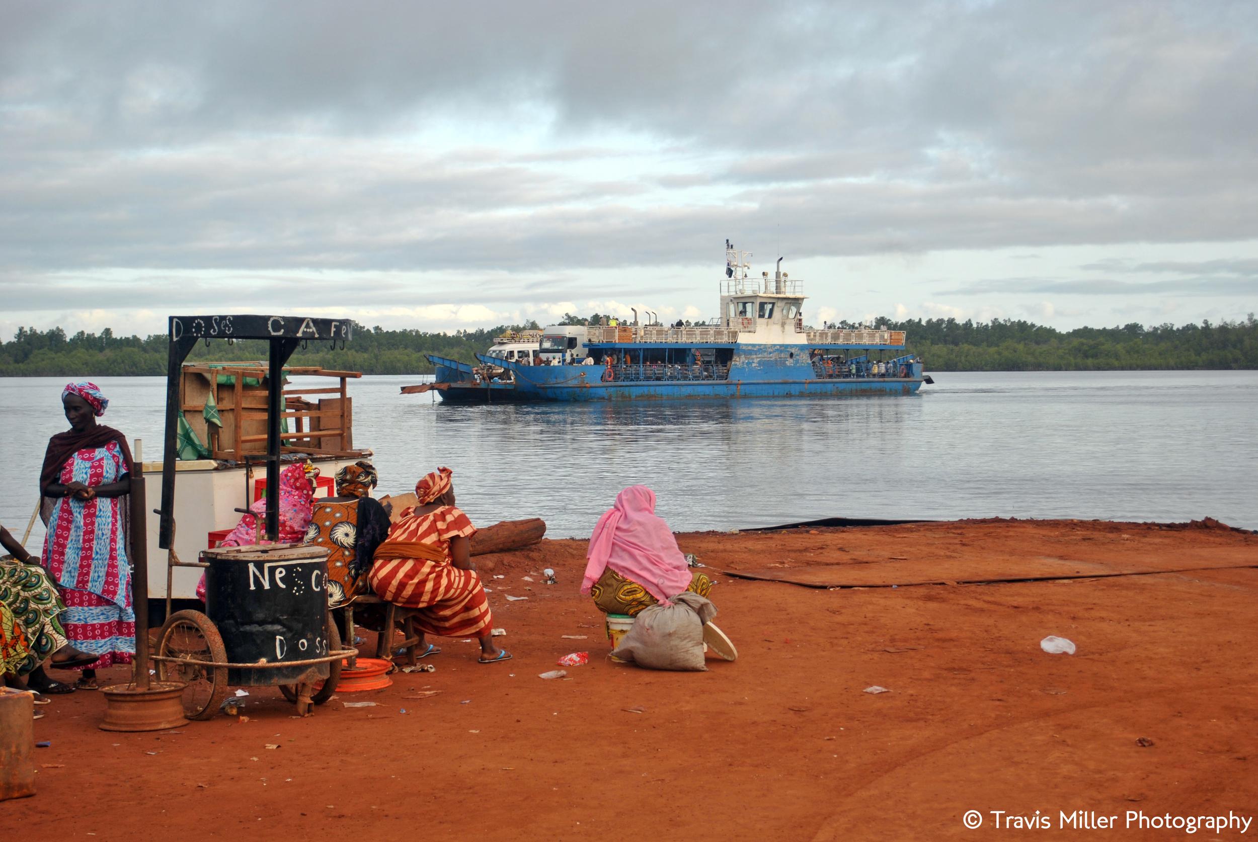 Waiting to Cross      Yelitenda, The Gambia