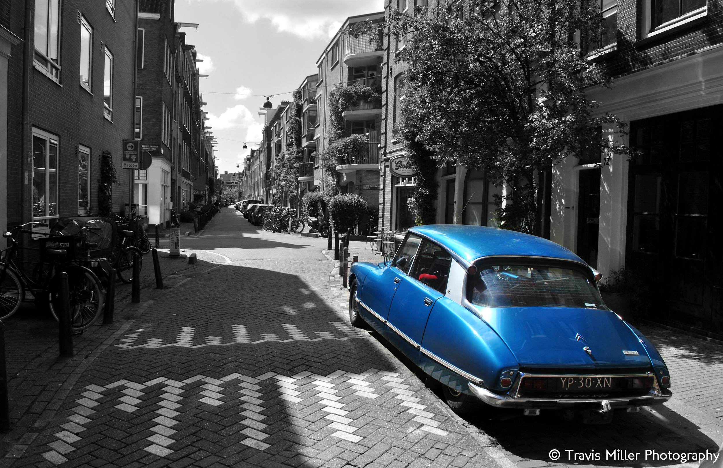A Blue Car at Midday in Amsterdam /  Amsterdam, The Netherlands