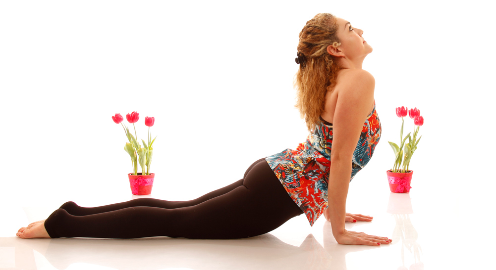 UPWARD DOG:Urdhva Mukha Svanasana  -tiny bend in the elbows -press into the feet to lift the knees and thighs off the earth -reach your heart through the shoulder