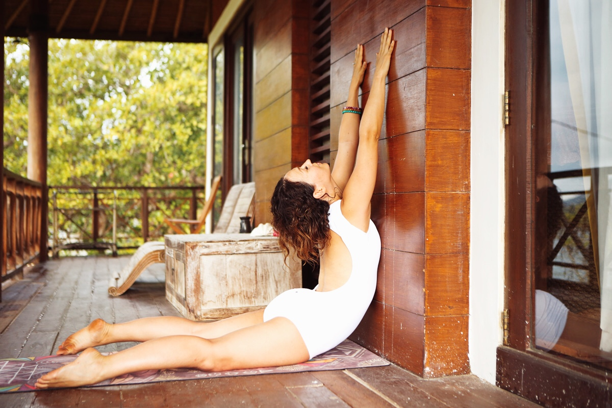 For an even deeper stretch, reach your arms up higher on the wall & take your gaze upwards. You will feel this intensly in the neck, heart & shoulders,