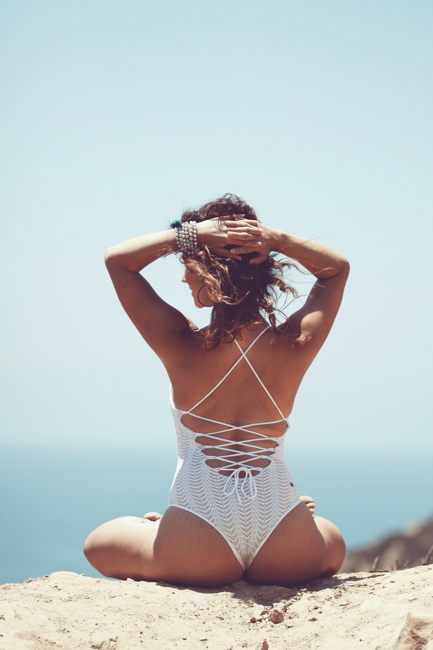 - WAYARA SWIMSUITEveryone should have at least one super cute one-piece swimsuit. The Wayara is your answer. Our adorable knitted overlay and lace up back makes this one of a kind!