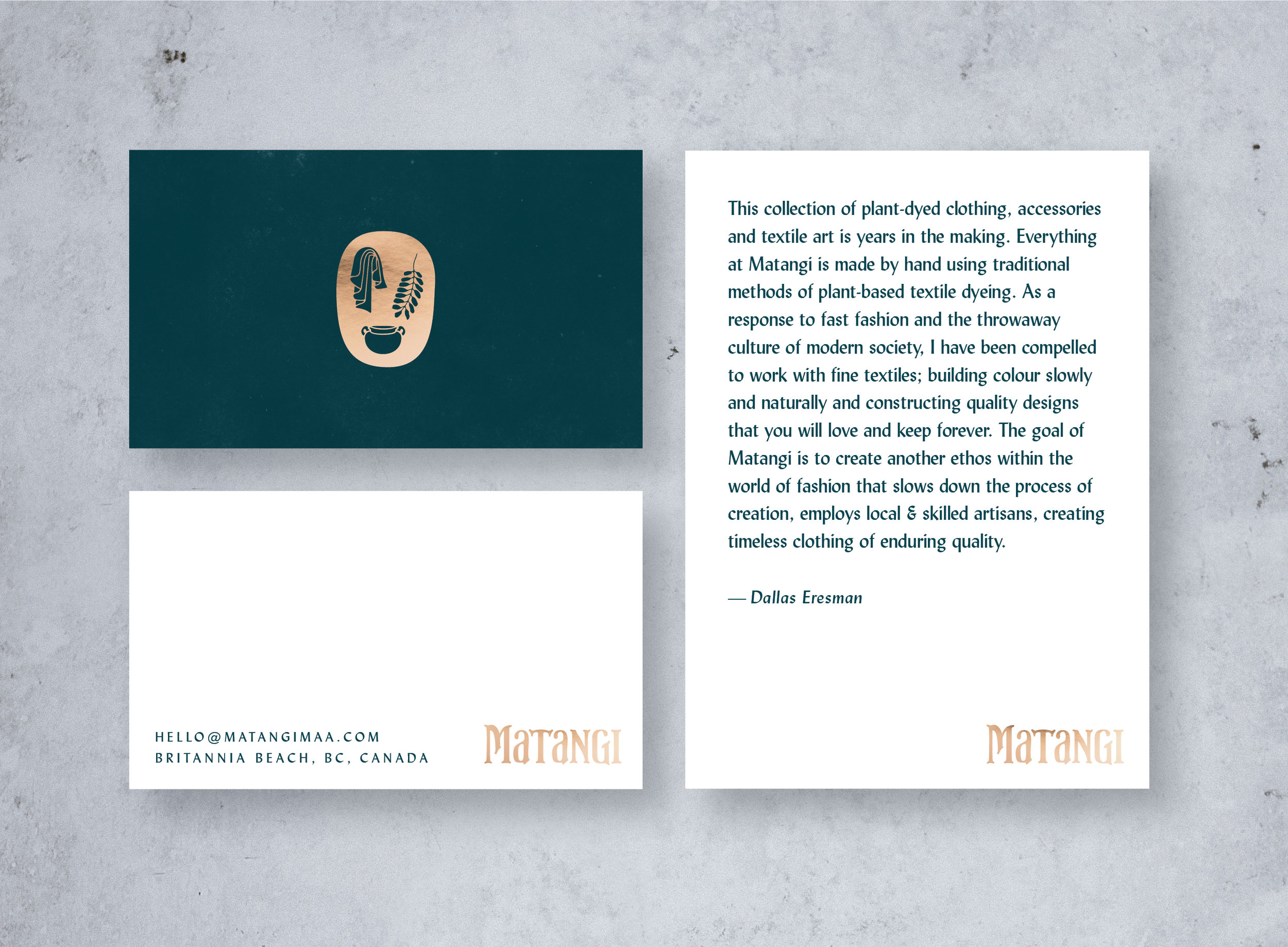 Branded collateral showing business card design and printed postcard with gold foil treatment