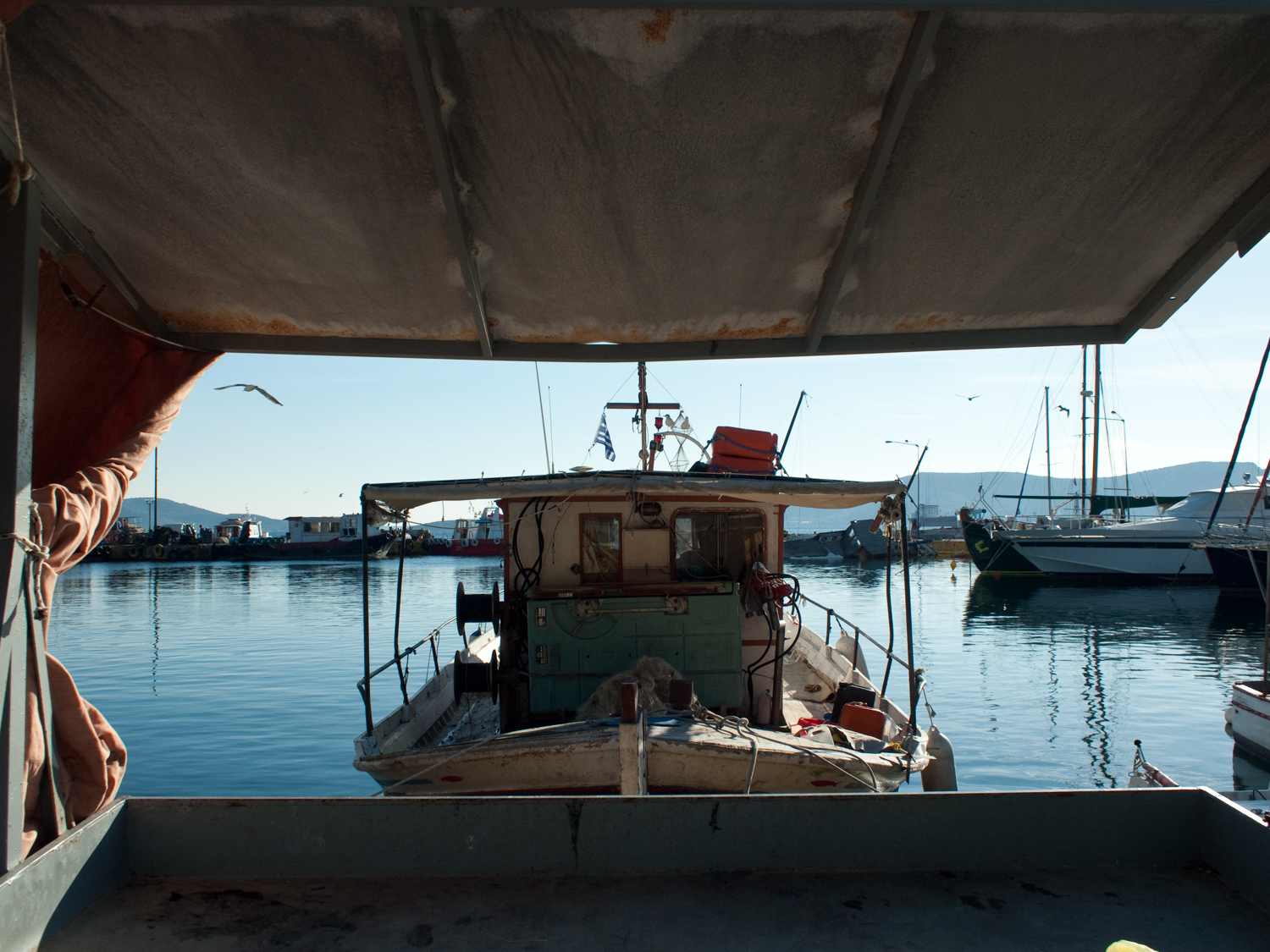 Traditional fishing boat on the waterfront of Eleusis.