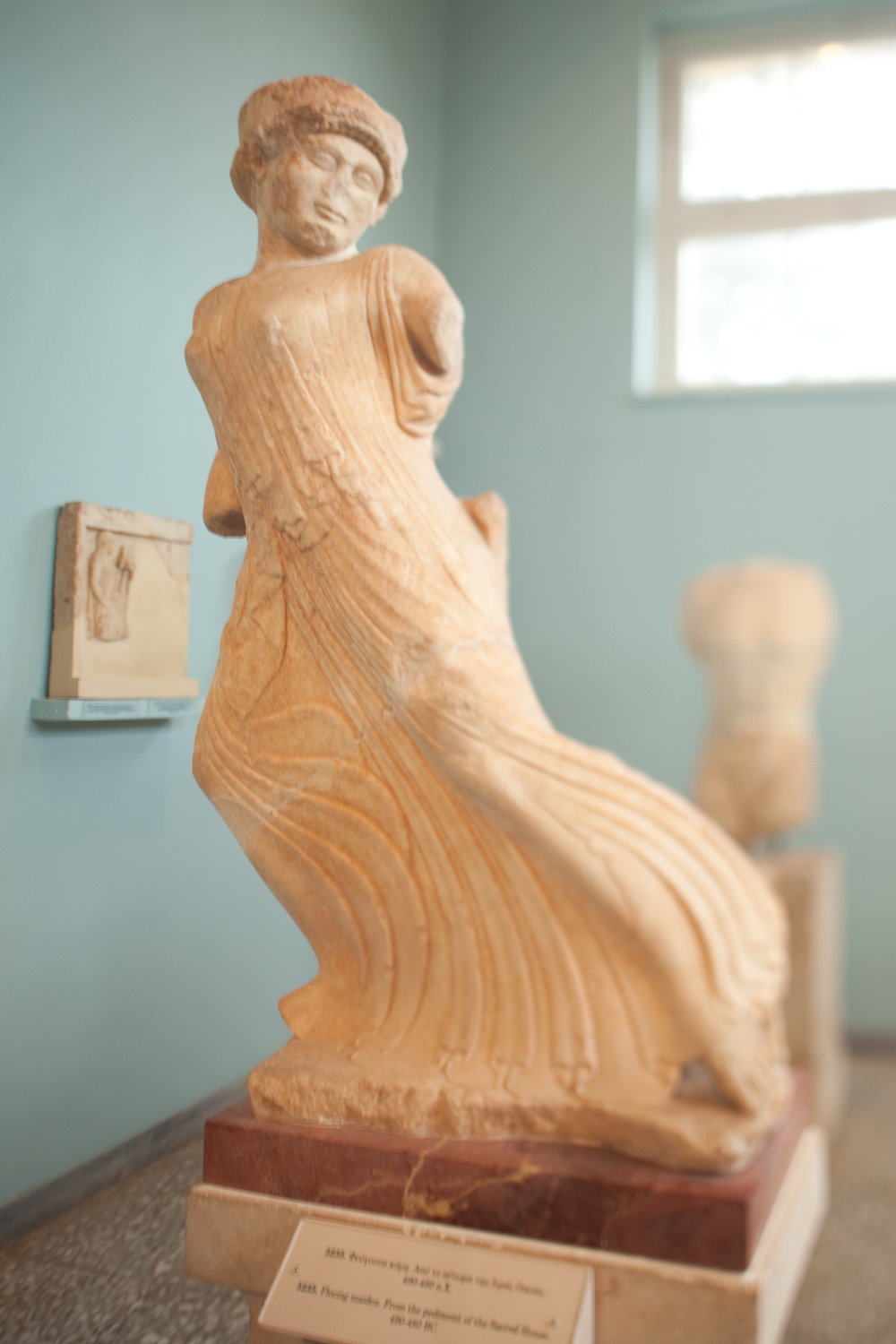 """The """"Fleeing Maiden"""" at the Archaeological Museum of Eleusis."""