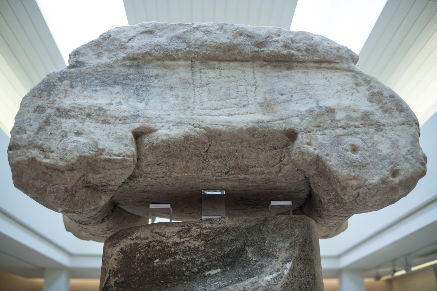 "Marathon ""trophy"" column. On the top of the capital can be seen the carving of a game board, most likely after the column was toppled and reused during the middle ages."