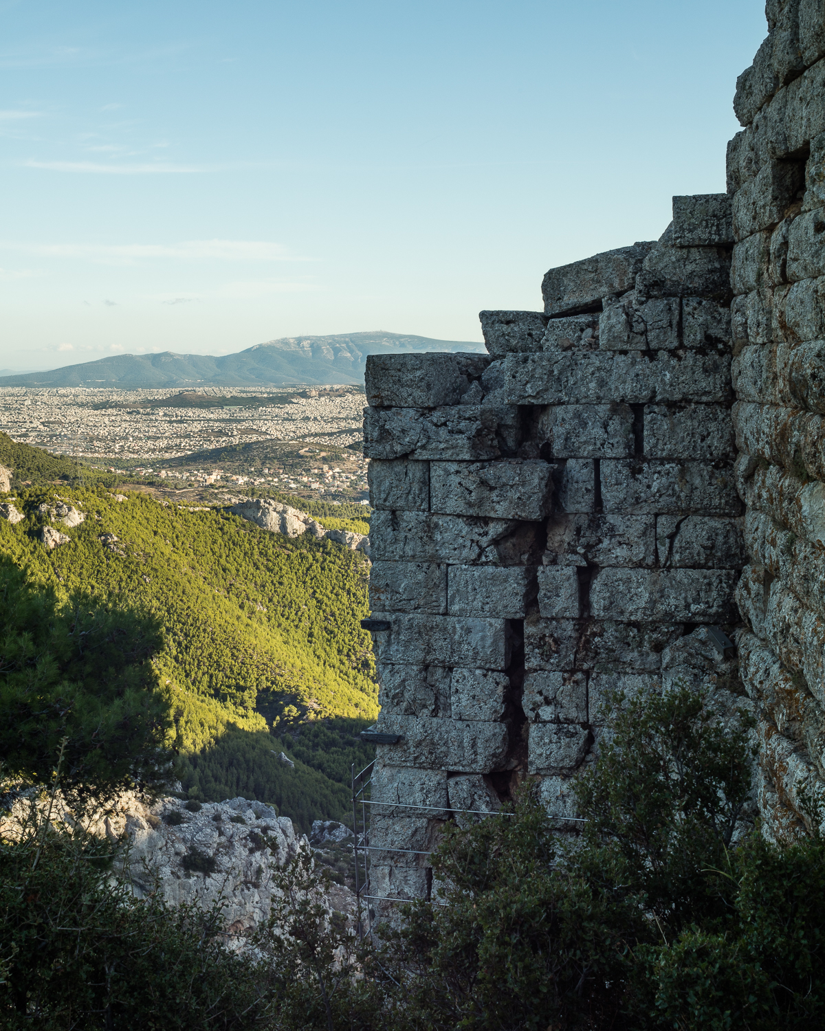 The ancient Fortress of Fili on Mt. Parnitha. Built around the 4th century BCE, the fortress consisted of four towers. Here the best preserved is seen overlooking the northern end of the city of Athens. View facing south with Mt. Hymettus in the background.