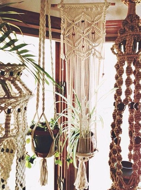 Seventies inspired macrame plant holders. The use of natural fibres and woven textiles were popular choices for home decor in seventies houses, forever reminiscent of the bohemian chic style that defined the free spirited era.