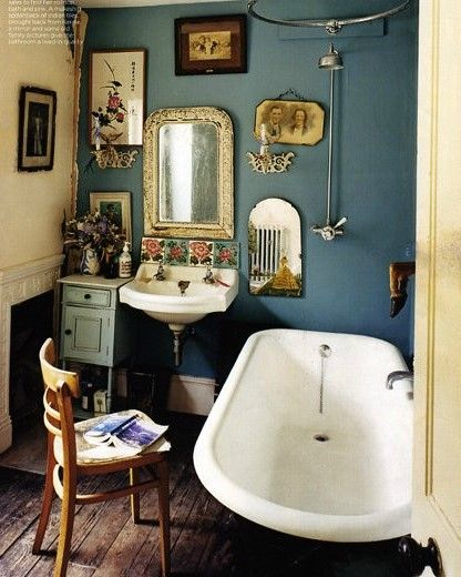 An actual modern day vintagebathroom created almost all original pieces, from a Victorian roll-topbath and antique furnishings.Image taken from Period Living magazine.