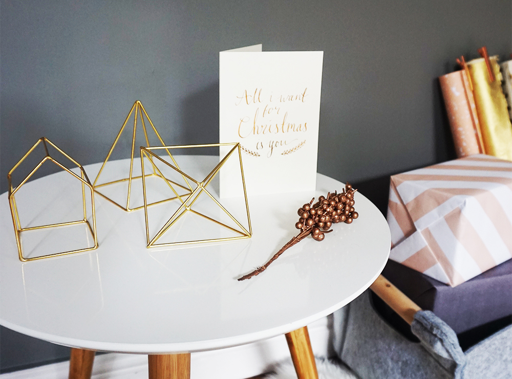 Bloomingville's  trio of gold geometric objects look beautiful displayed on tables, shelves and window ledges. Festive with the capital F. 'All I want for Christmas' by  Katie Leamon .