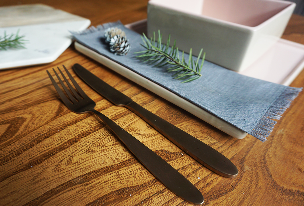 Super special copper cutlery by  Bloomingville . Rose pink contemporary dinnerware also by  Bloomingville .