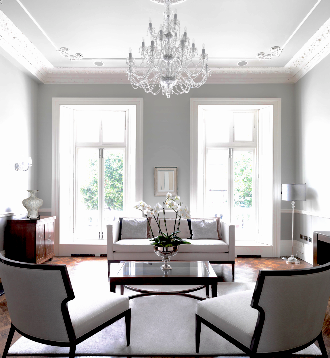 Drawing room in pale greys and whites, parquet flooring