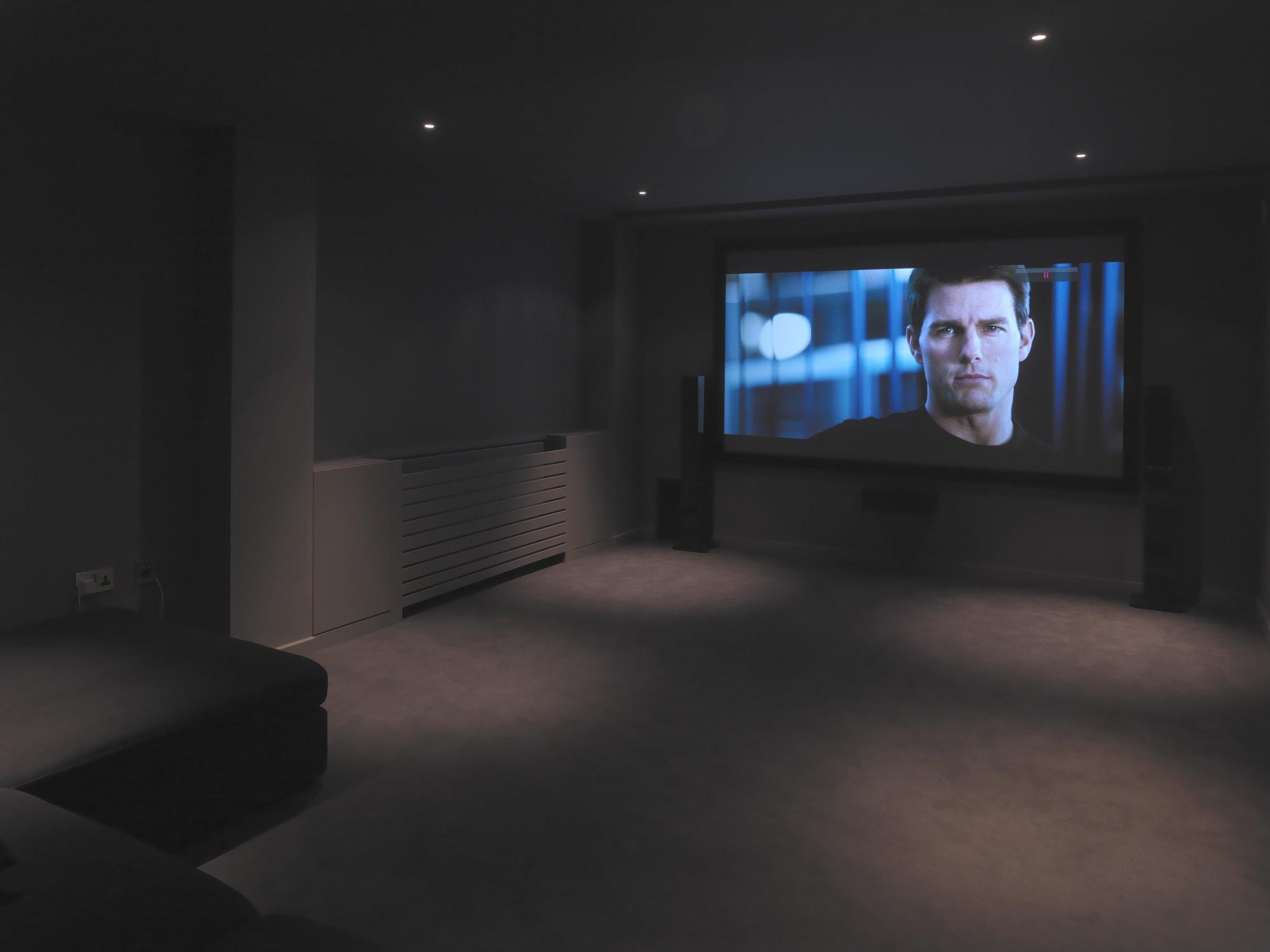 Media room in sub-basement in darker tones