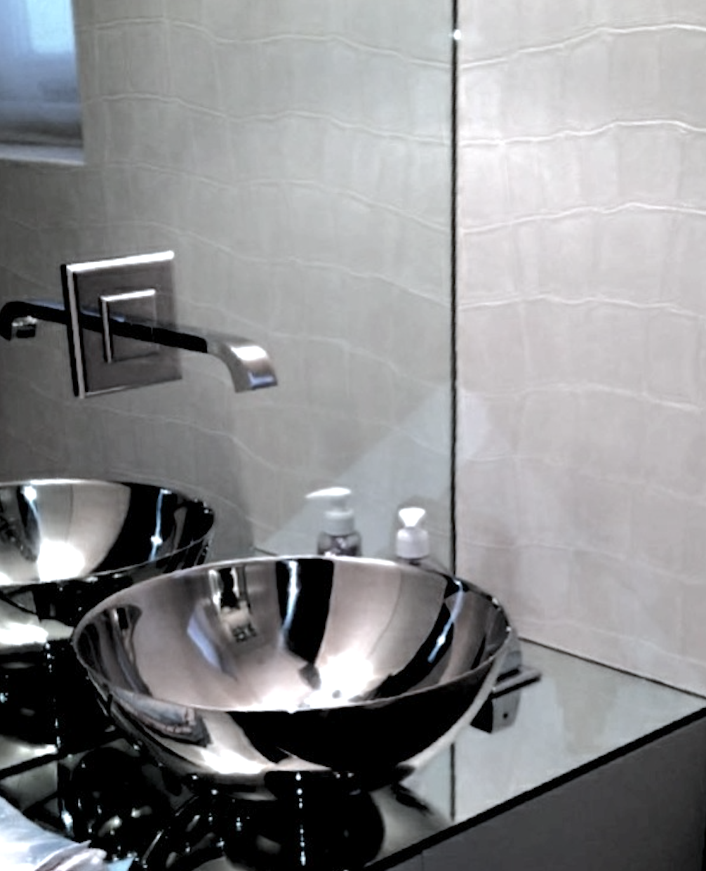 Mirrored cloak room on First Floor with ceramic silvered sink and crocodile finish wall paper