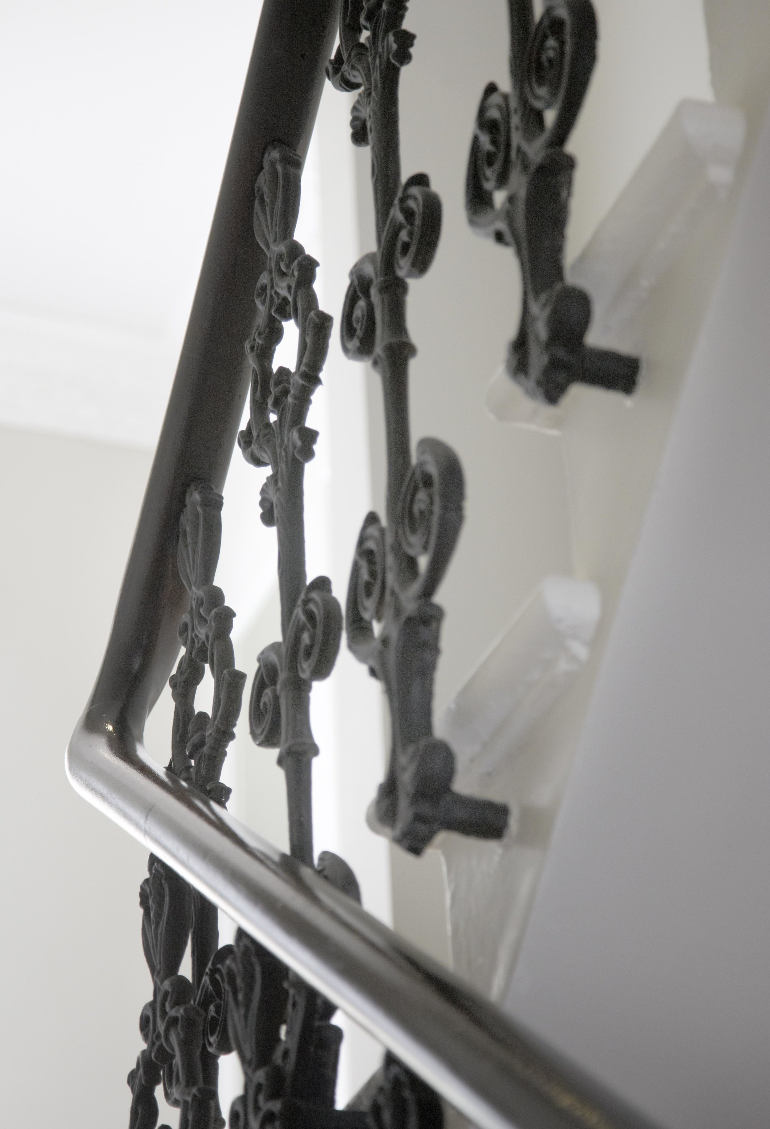 Matt black painted balusters and mahogany banister, French polished