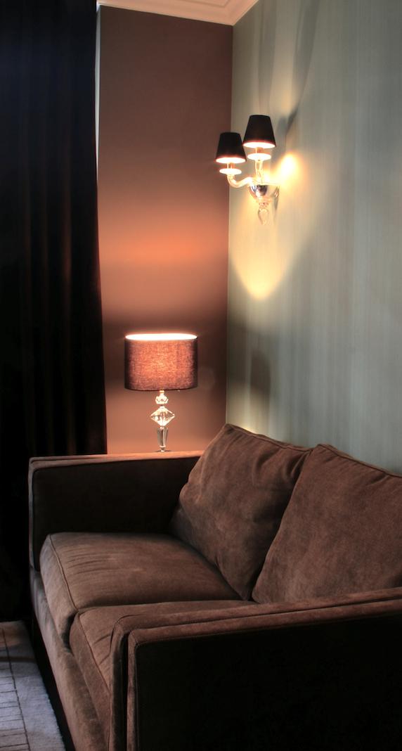 Blue strié wallpaper, wool finish sofa, art deco lamp and linen shade, velvet curtains
