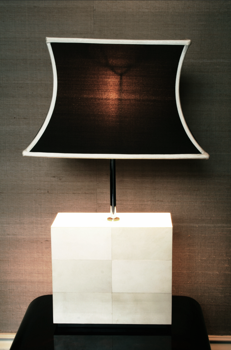 Bespoke parchment table lamp, linen shade, against bronze silk wallpaper