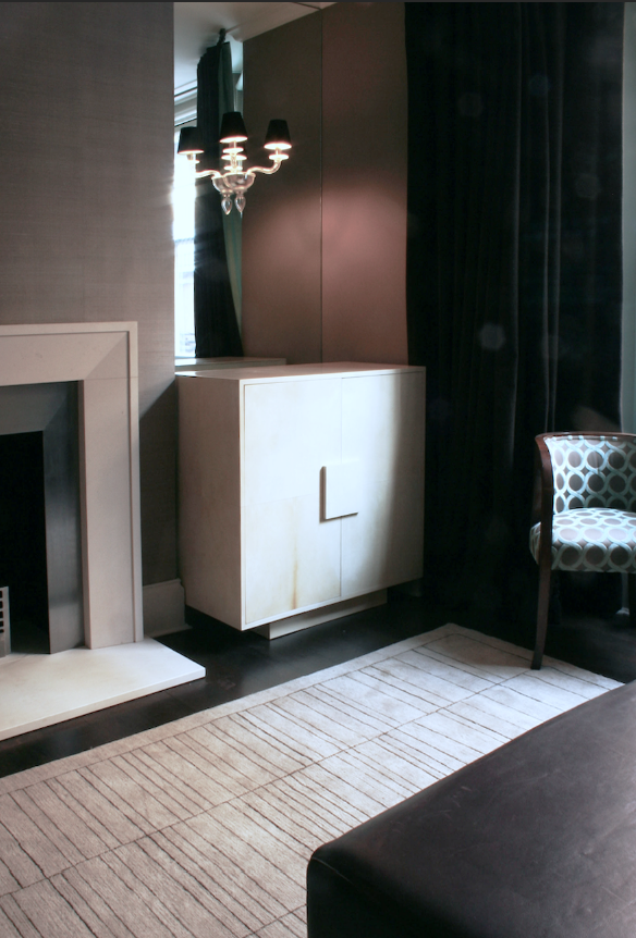 Bespoke parchment TV cabinet, against antiqued mirror and Murano glass wall lights with chocolate suede shades