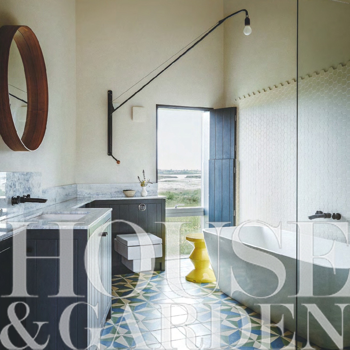 Guest bathroom, geometric encaustic floor tiles, bespoke cabinetry, Prouve light, hexagonal wall tiles with detailed edge
