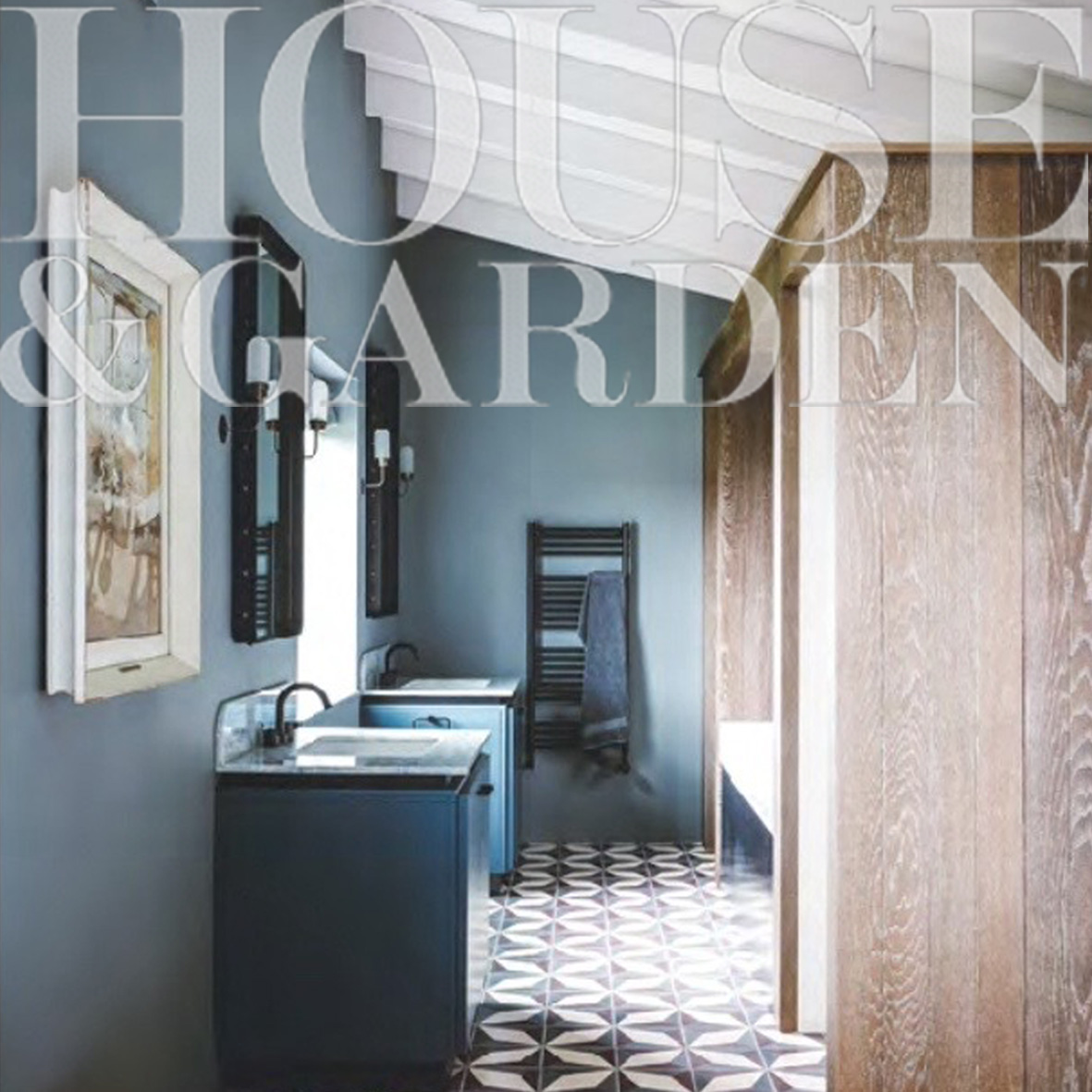 Master bathroom with geometric encaustic tiles, oak clad and steel bathing cabin, flanked by WC and shower cubicles