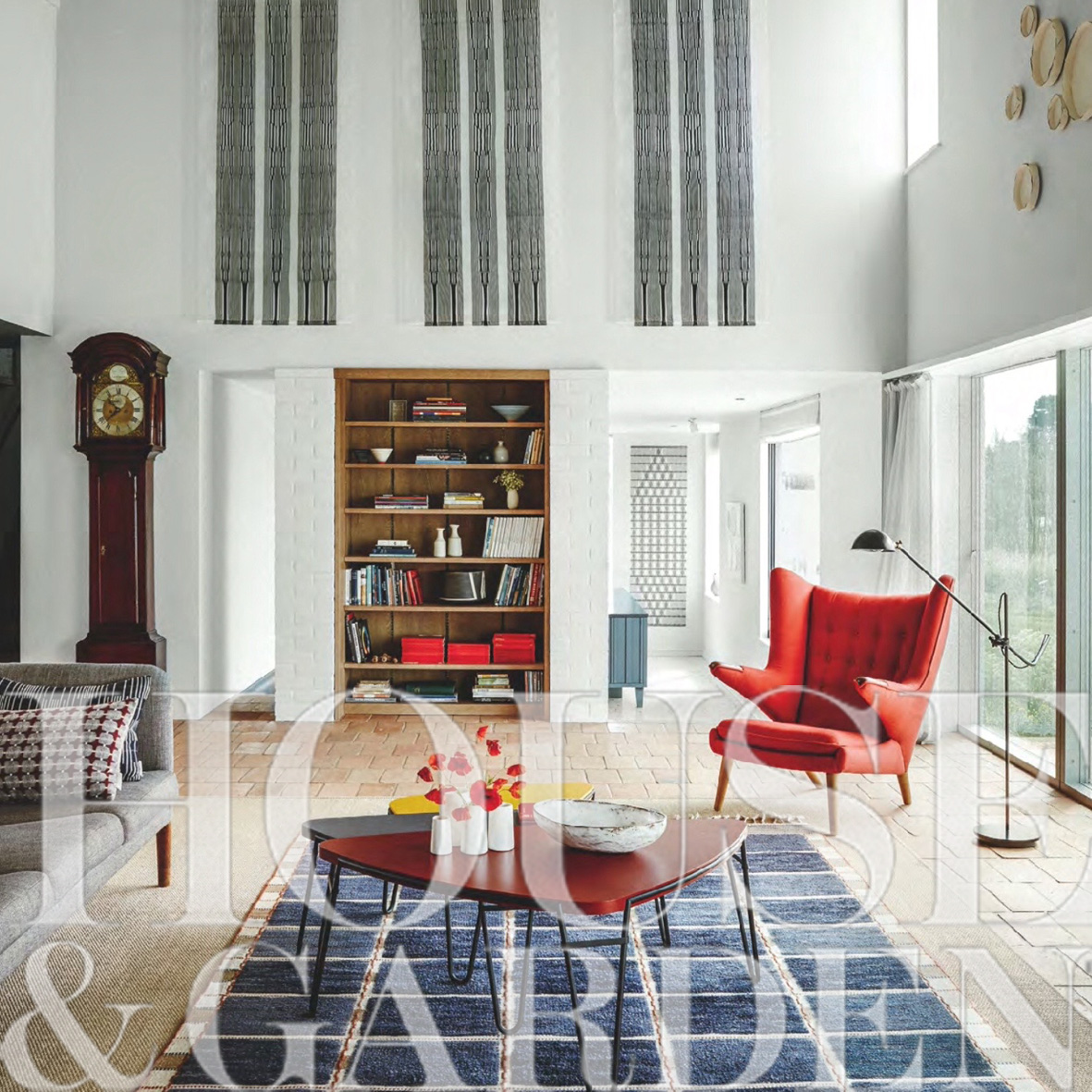 Sitting room with vaulted ceiling, pamments on floor, and sliding doors to the gardens