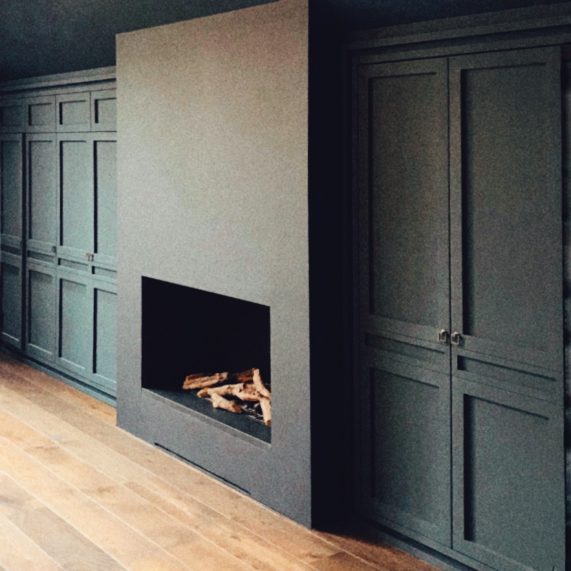 Bespoke cabinetry to conceal TV, home office, and bespoke gas fire