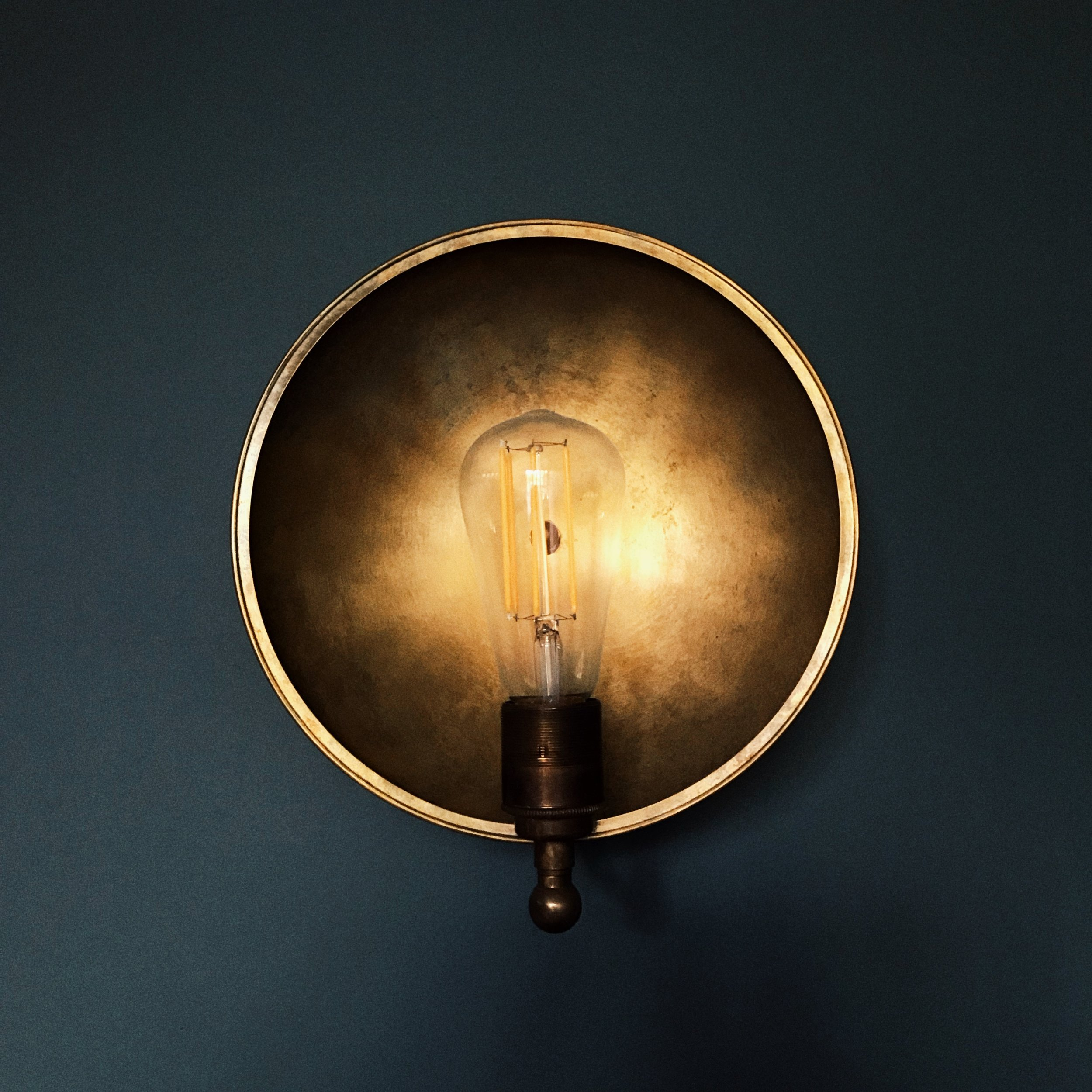 Detail: Brass wall lights and ceiling pendant