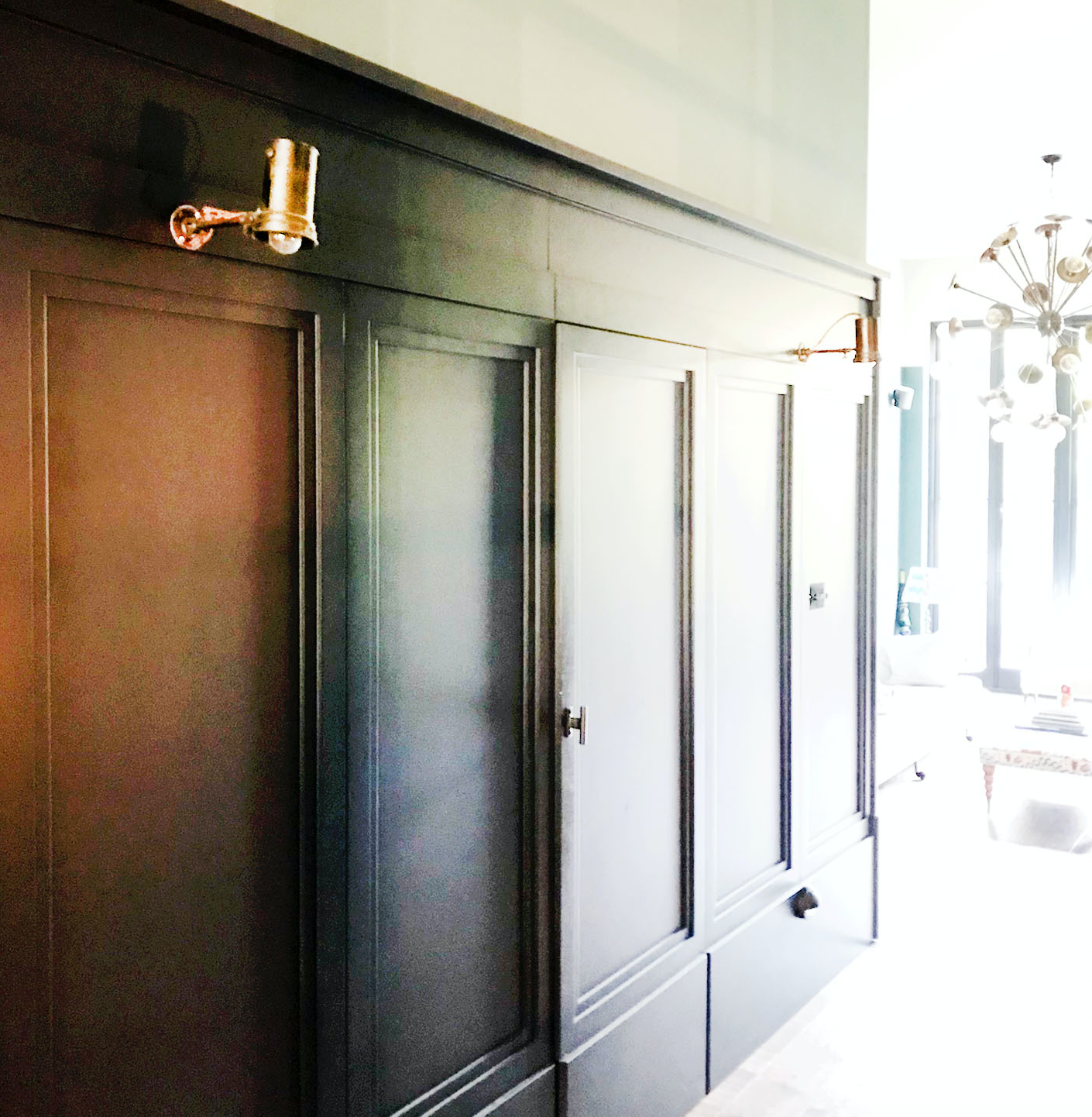 Hall, bespoke panelling was created to conceal jib door to laundry, and to create visual interest