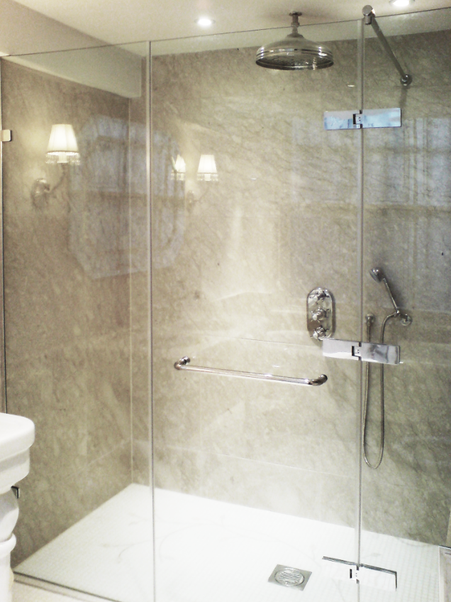 En-suite Master Bathroom, with warm cream marble, hand made mosaic floors, nickel fittings, French double ceramic double basin