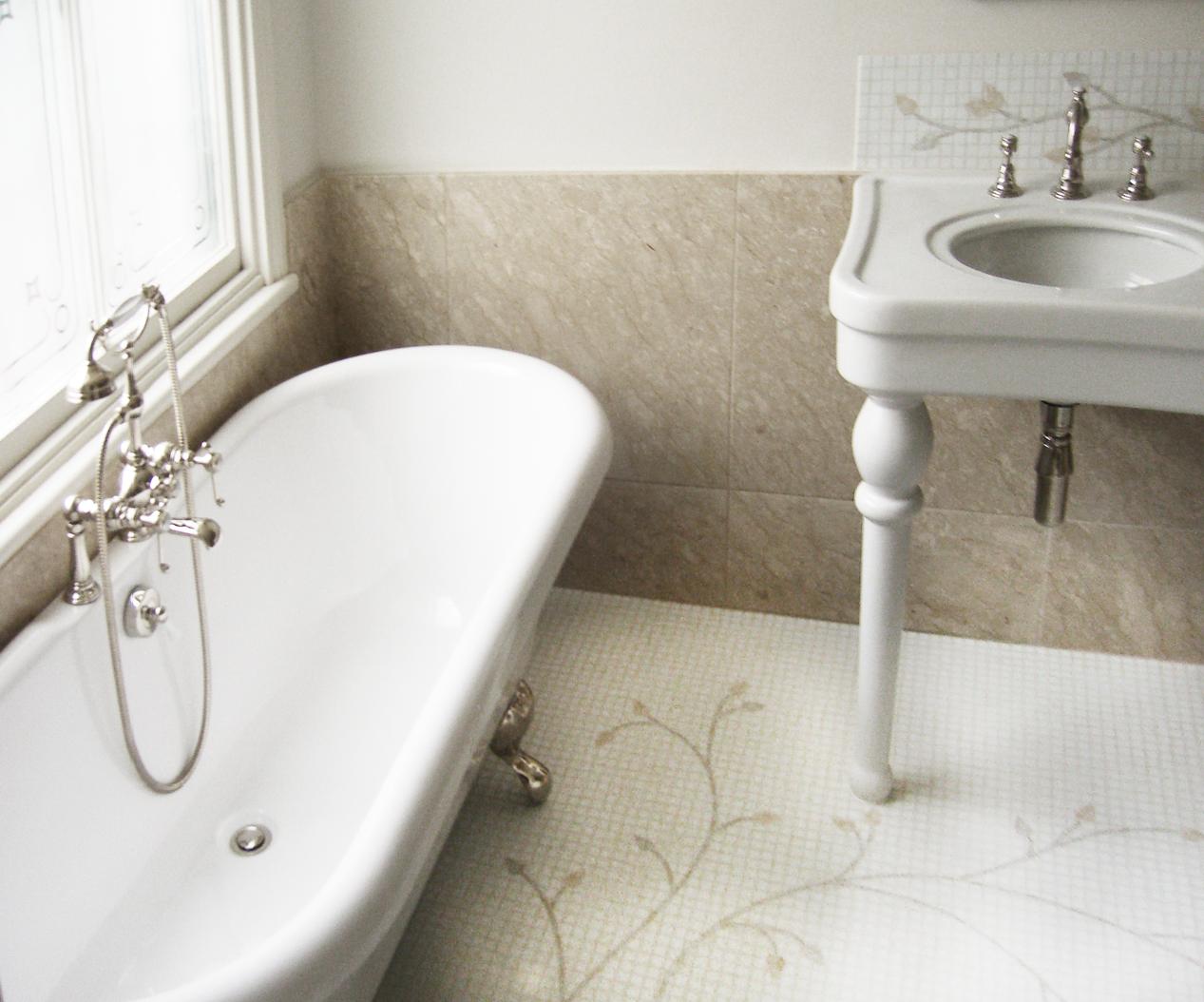 Nickel footed claw foot bath, hand made mosaic floors, ceramic basins