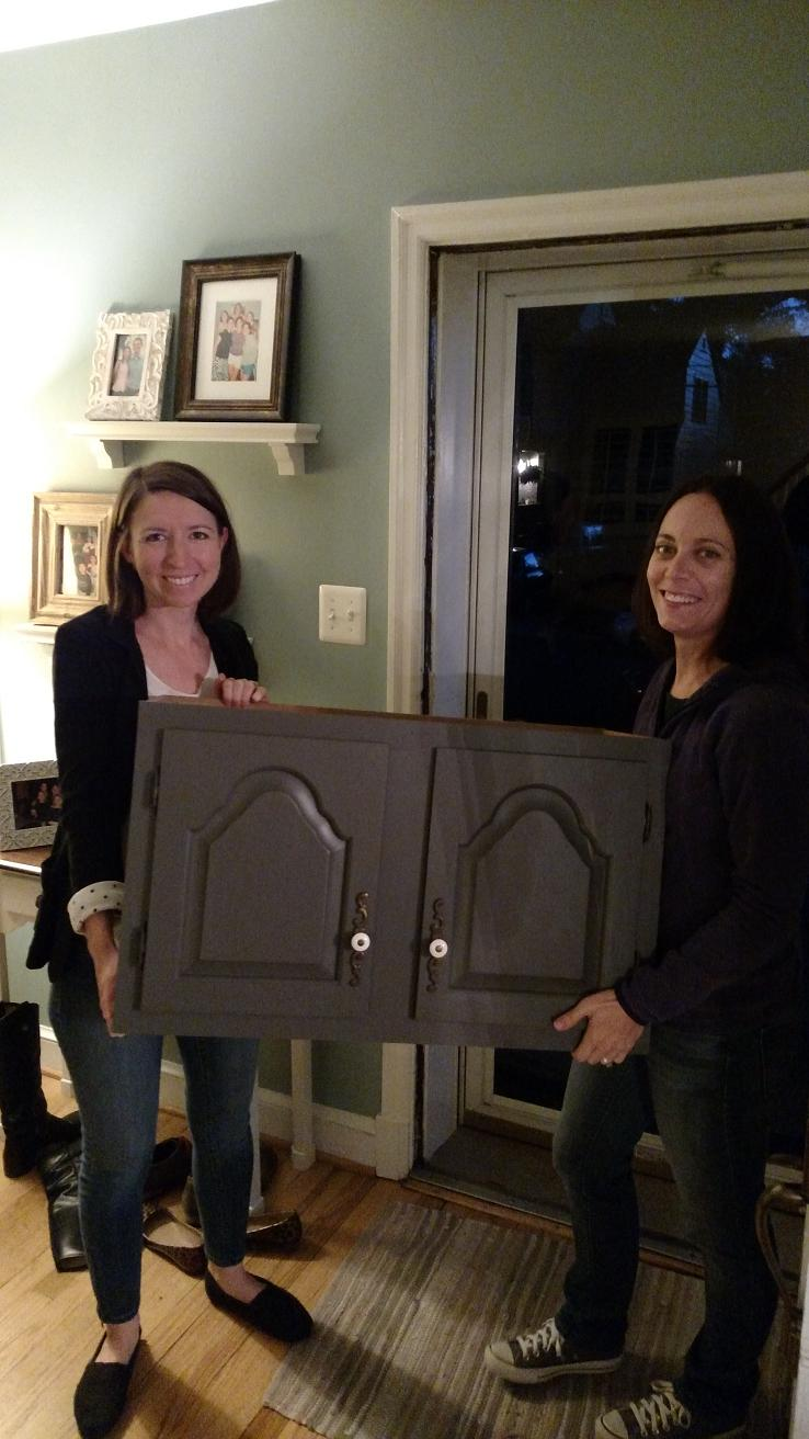 Us with cabinet. Original fixtures. Yes, it's still dark outside.
