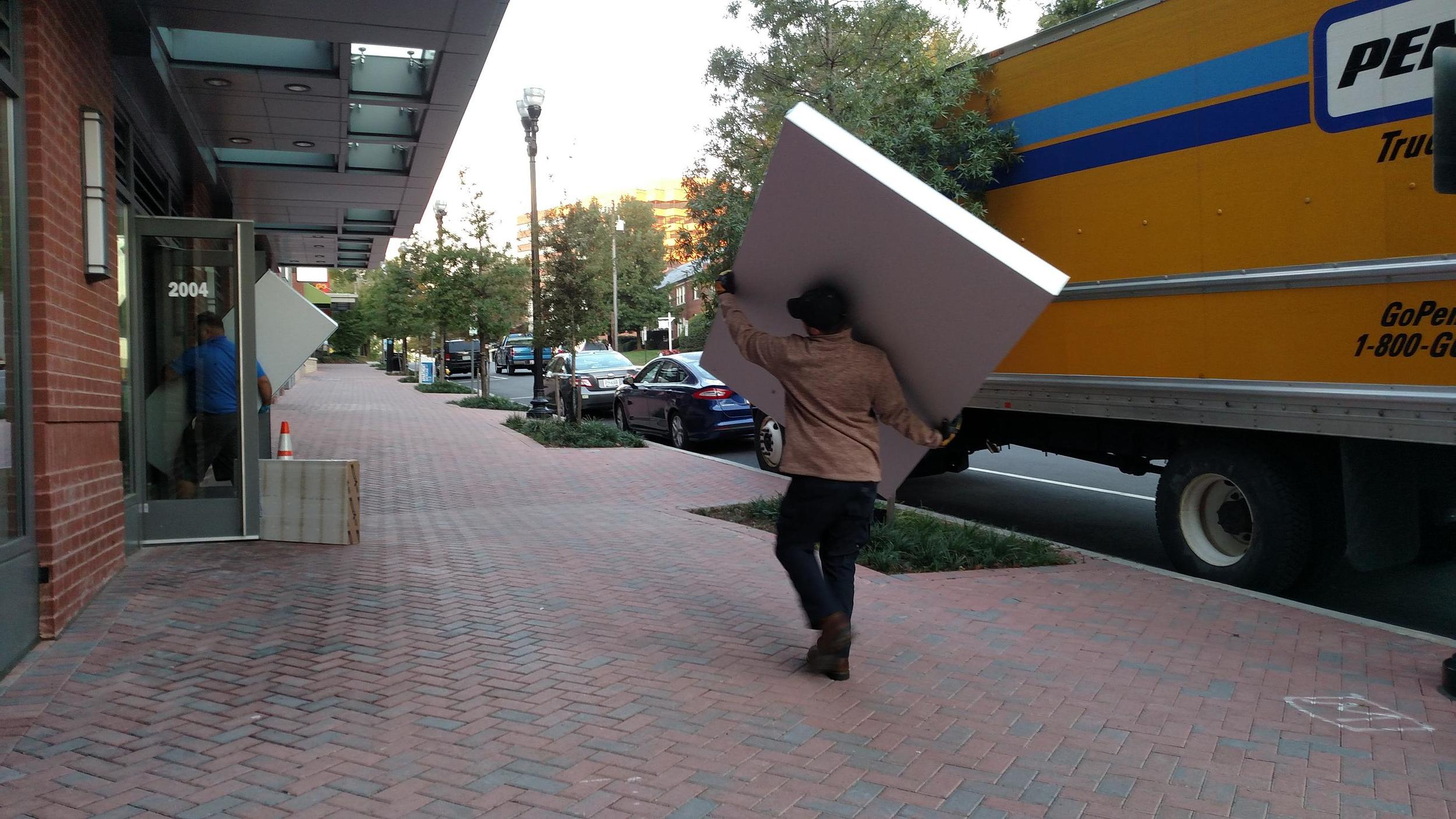 These guys carried the panels in by themselves. At 7am. We were impressed.