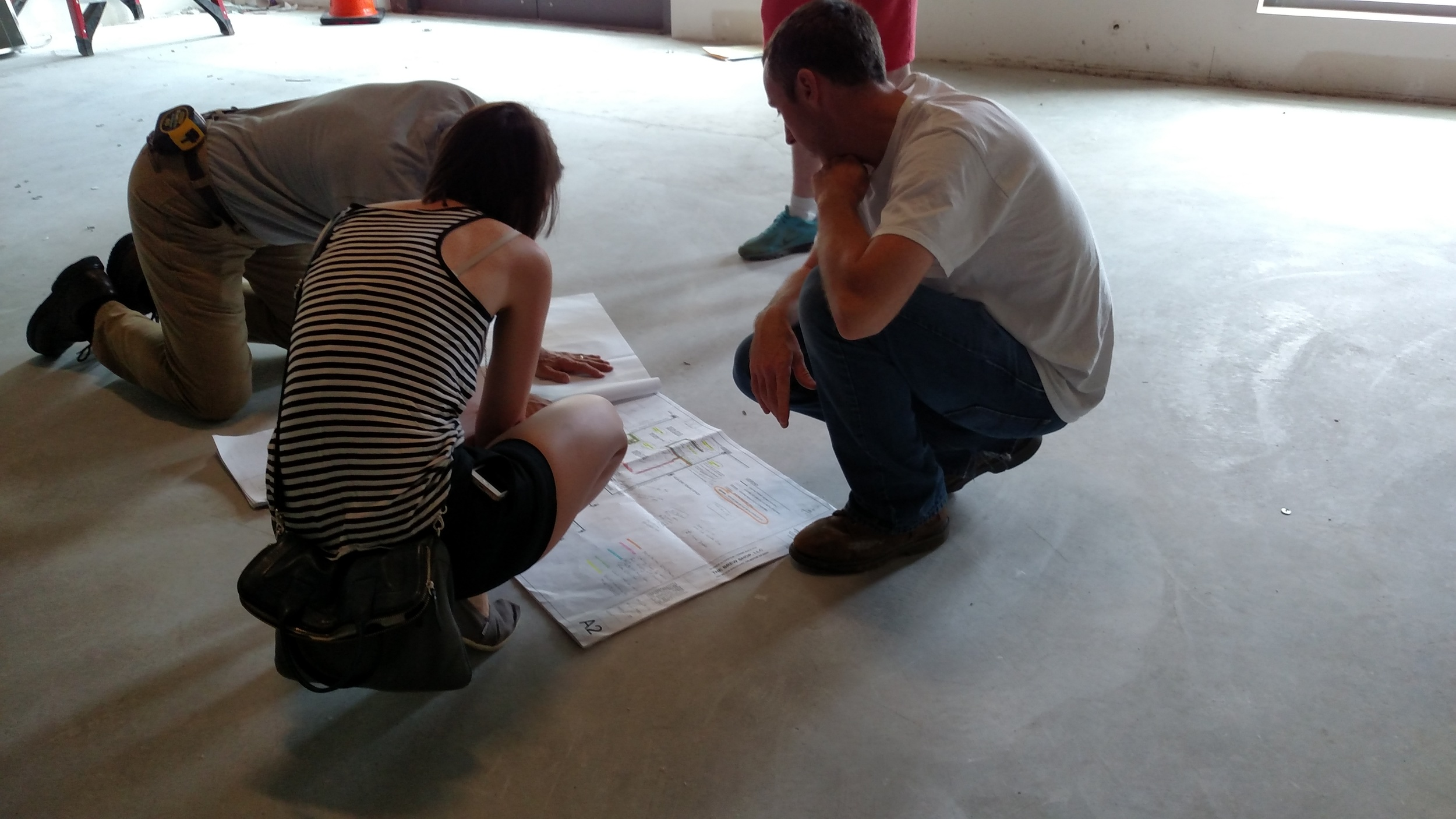 Going over the architectural drawings with our GC and Carpenter