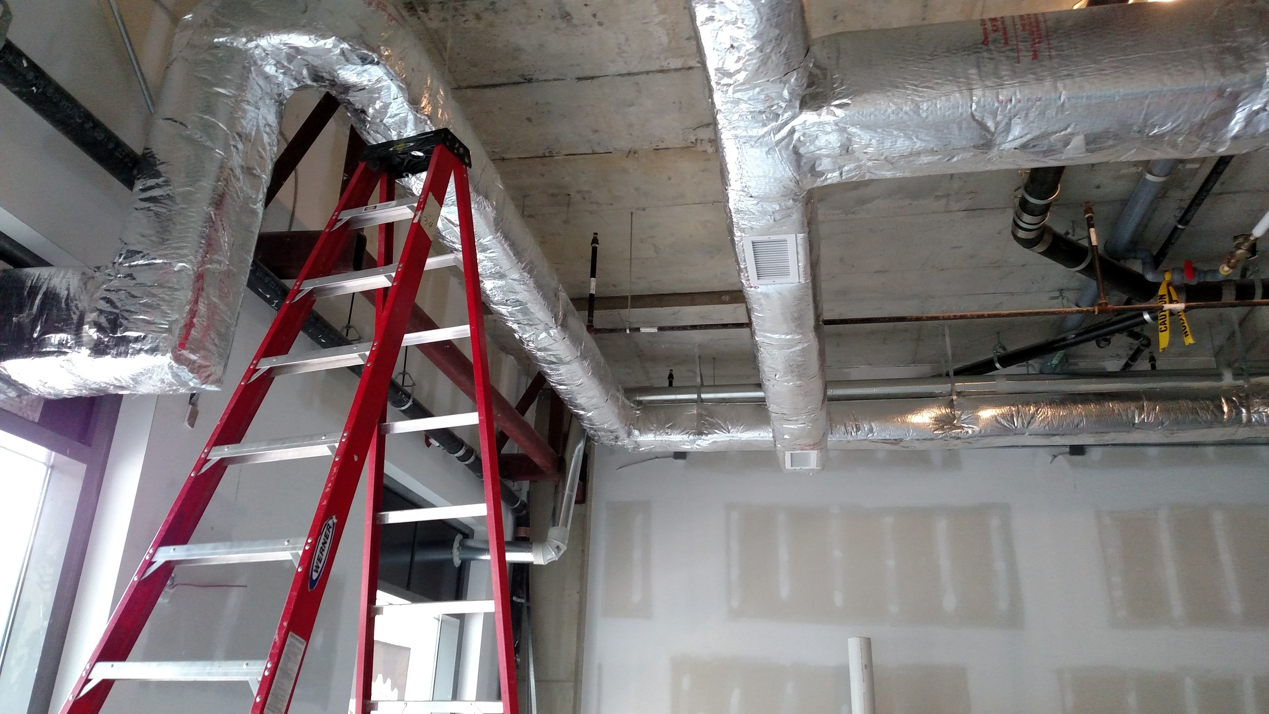 HVAC duct work wrapped and insulated