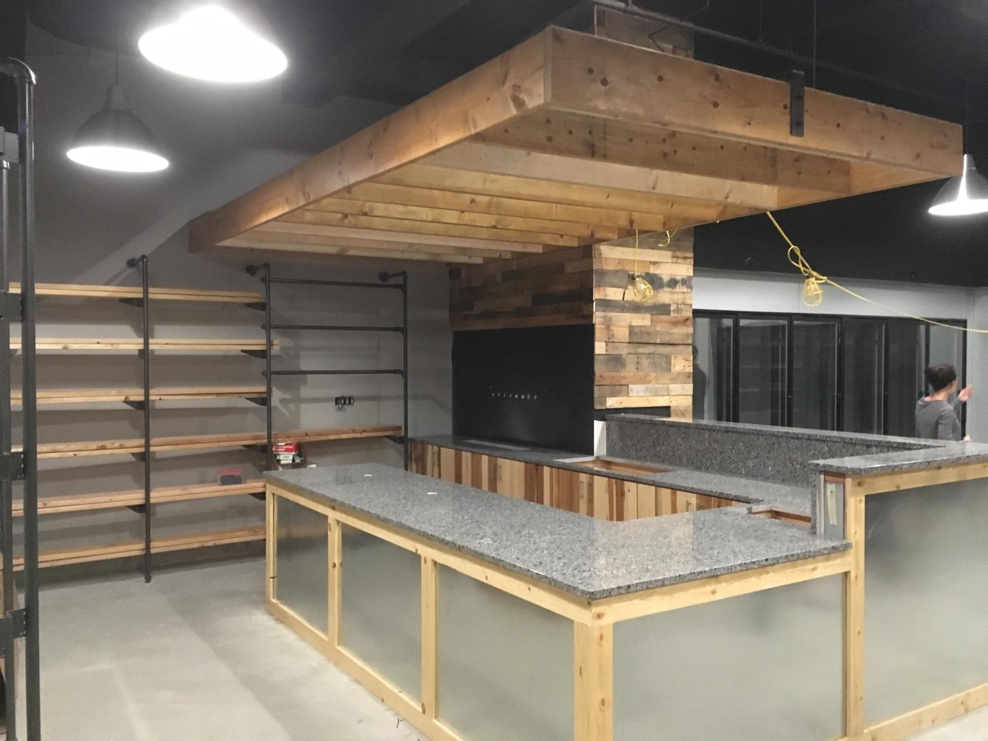 New, shiny countertops and hanging pendants almost make this picture look fake (It's real!)