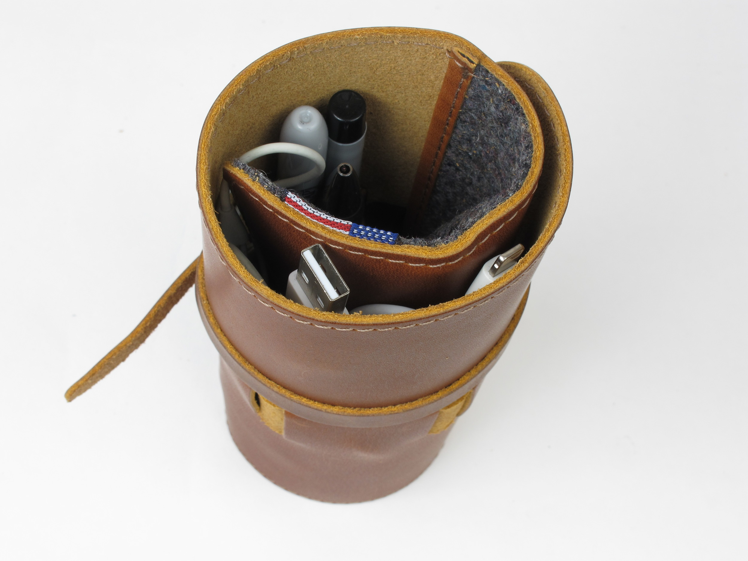 Cord Wrap with leather cover and interior felt pocket