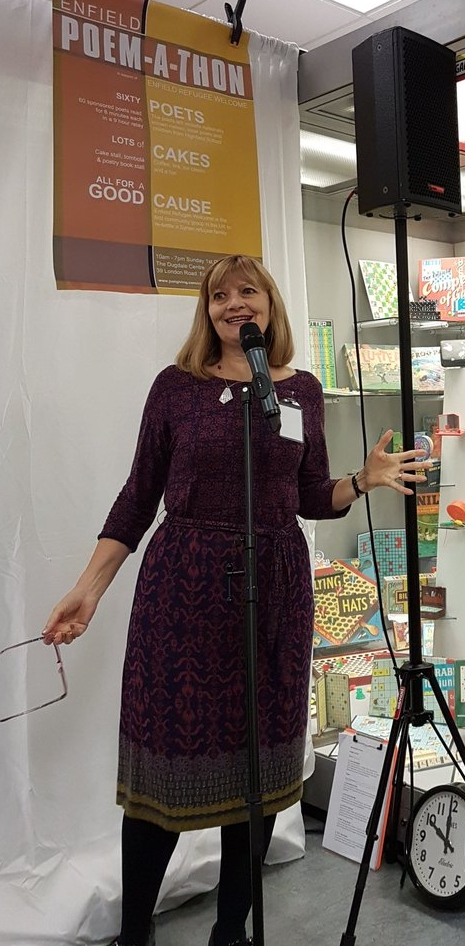 Photograph from twitter account,   @ poem_a_thon   : Maggie Butt launching the event.  Enfield Poem-a-thon @poem_a_thon  #poemathon  - and we're off!