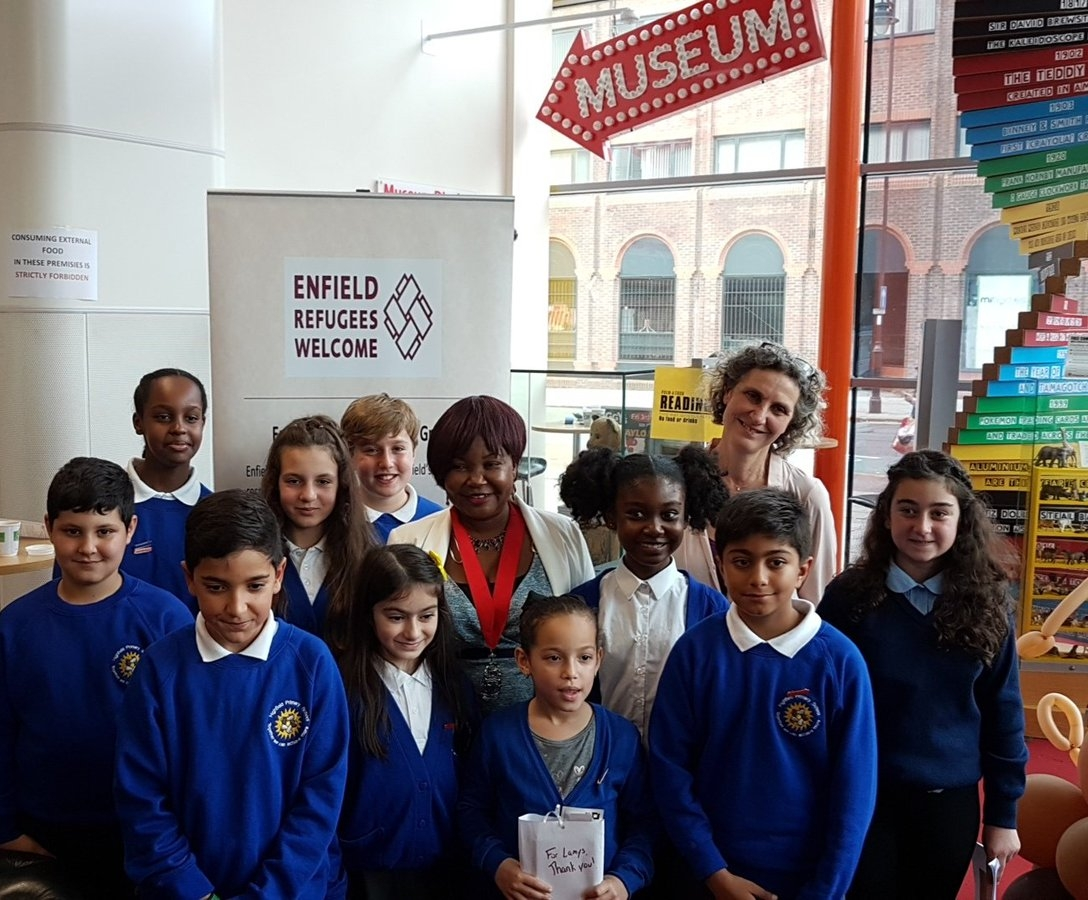 Photograph from twitter feed account   @ poem_a_thon   : Children from Highfields school  @MayorofEnfield  and   @cherylmoskowitz  celebrating  #enfield   #poemathon