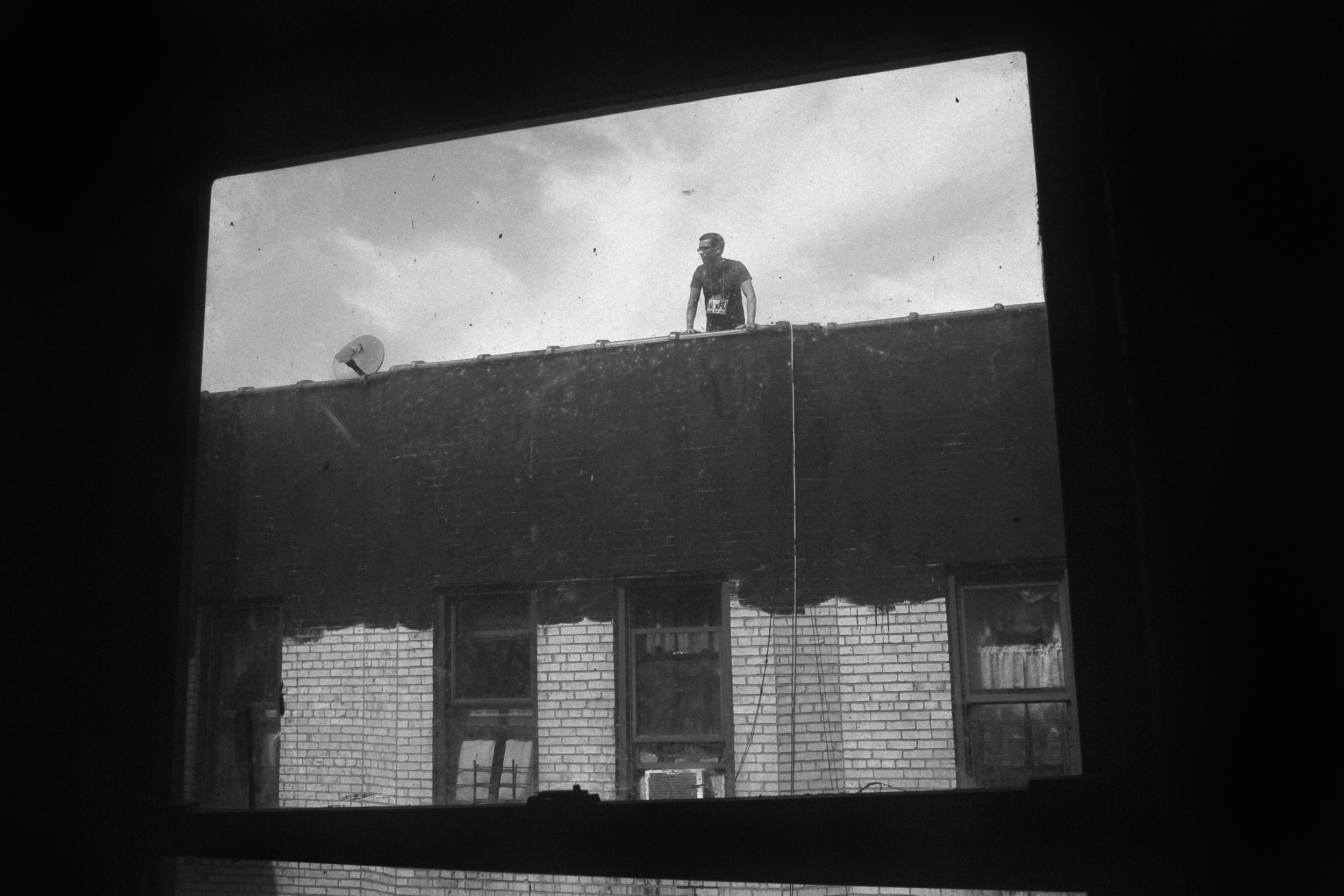 LOVE LIVES. Angel on rooftop. Hunts Point, the Bronx, NYC. September 2012.