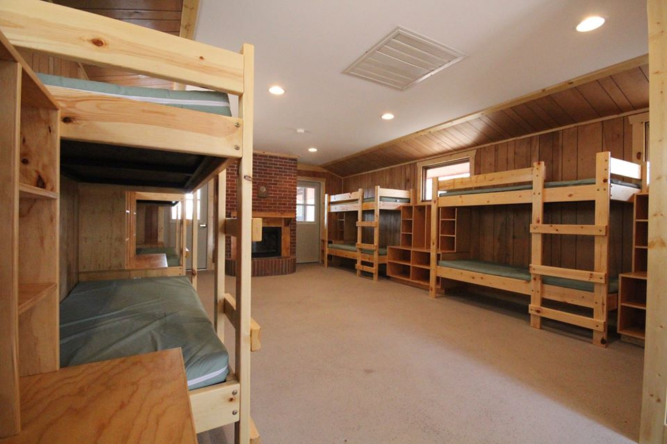 This doesn't just count for new construction.   McGaw YMCA Camp Echo  has retrofitted some cabins to be much more hygge.  Again, fireplace, wooden construction details (including the awesome bunk beds).