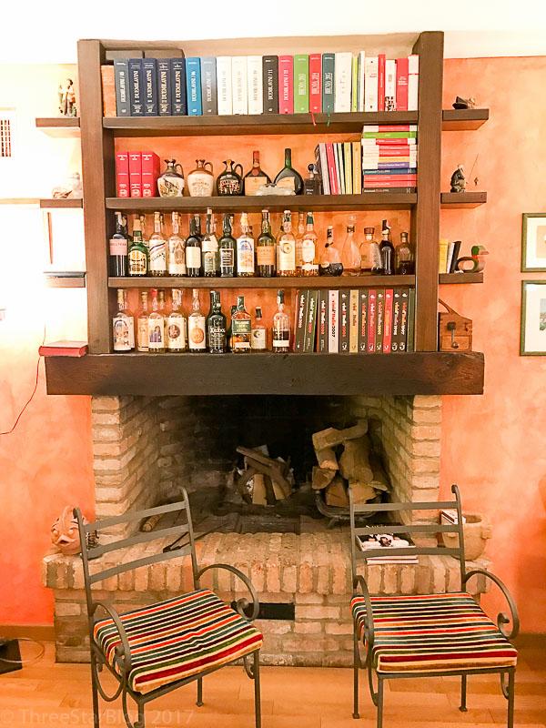 Second Fireplace- and Amazing Liquor Shelves